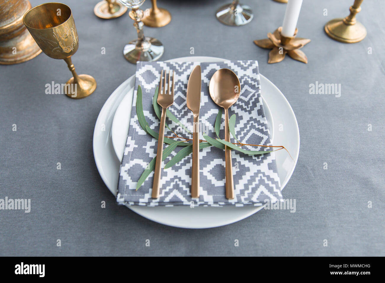 close up view of rustic table setting with vintage tarnished ...