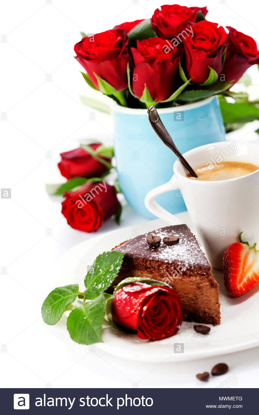 Piece Of Chocolate Cake With Coffee And Beautiful Flowers Stock