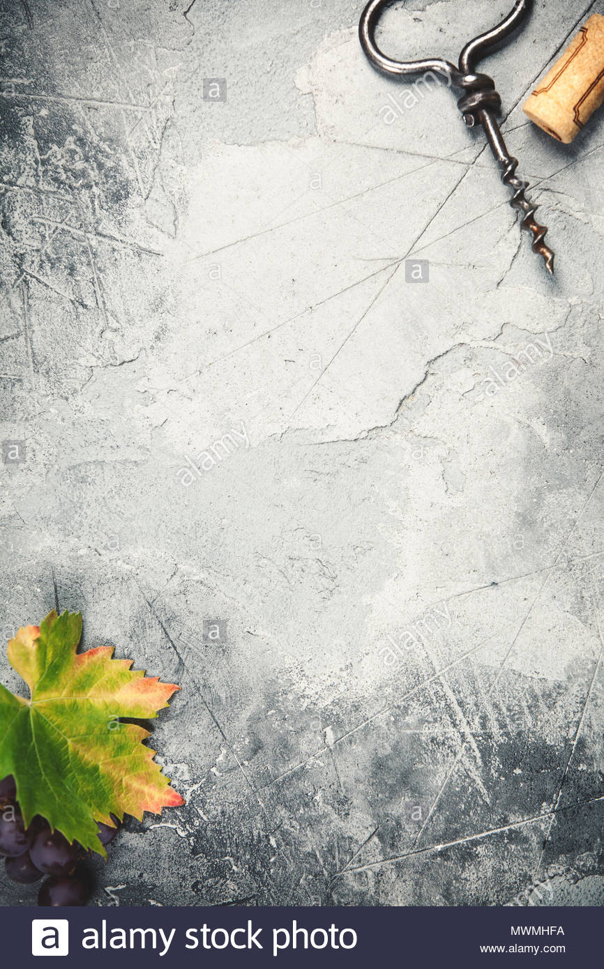 Top View Of An Old Cork Screw And Grape Leaf On Gray Concrete Background With Space For Text A Vertical Design Template Tasting Invitation Or