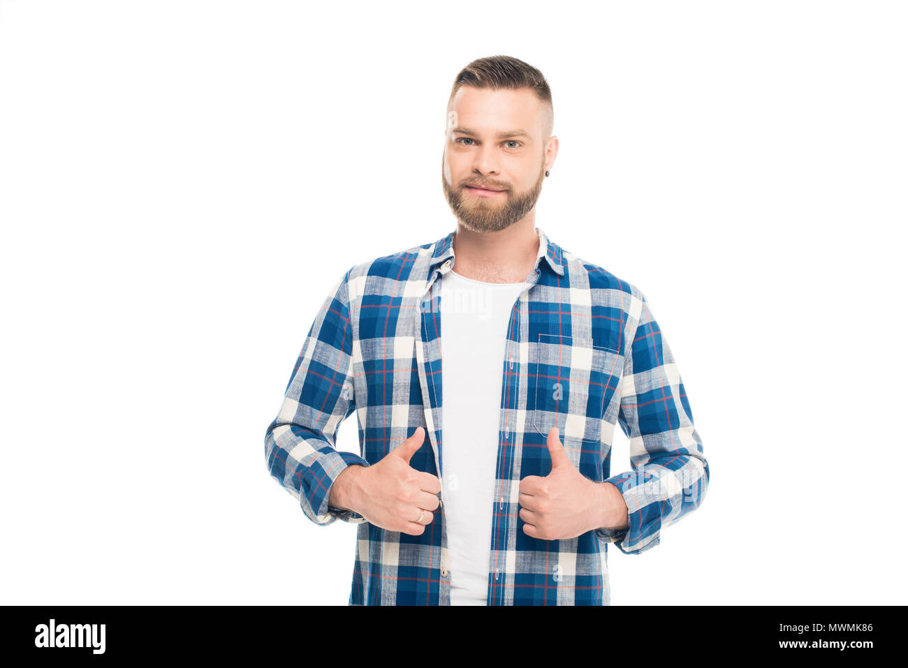 8affb0cba3d Bearded man in blue checkered shirt standing with thumbs up ...