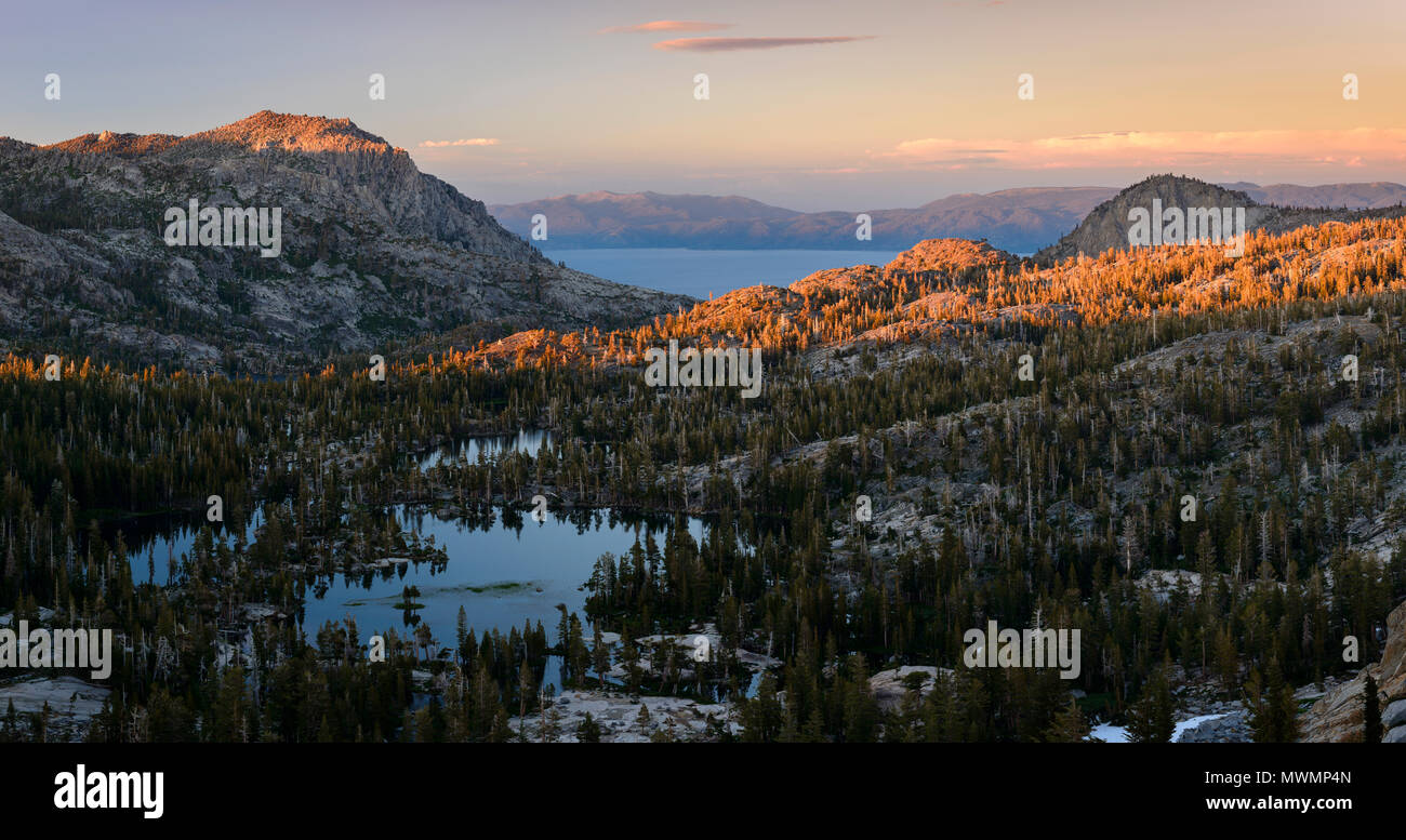 Upper Velma Lake and Lake Tahoe at sunset as seen from Fontanelles lake in Desolation Wilderness. Stock Photo