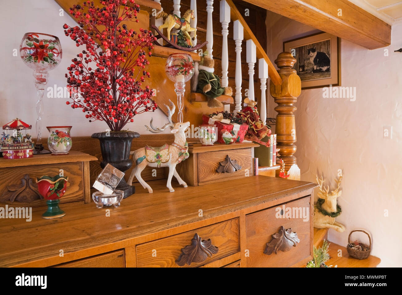 dresser with christmas decorations inside the living room of an old canadiana cottage style residential - Cabin Style Christmas Decorations