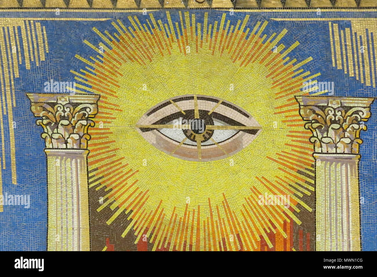 Close-up of the All-Seeing Eye and Corinthian pillars in the ceiling mosaic on the coving of the Grand Temple, Freemasons Hall, London - Stock Image
