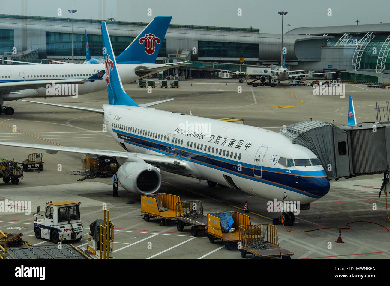 Wuhan, China - March 14, 2018: China Southern airplanes parked at Wuhan airport Stock Photo