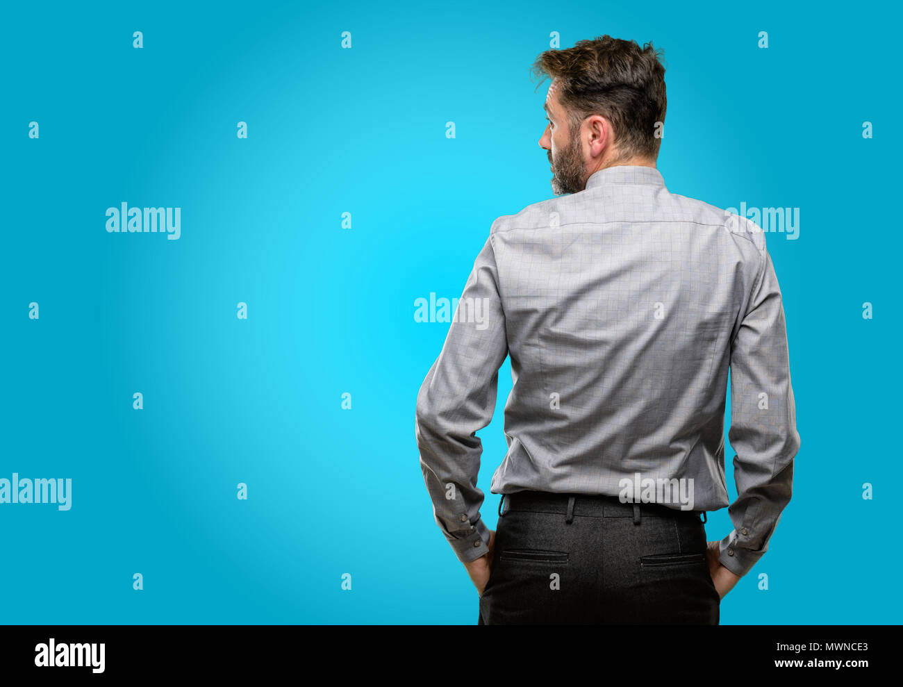 Middle age man, with beard and bow tie backside, rear view - Stock Image