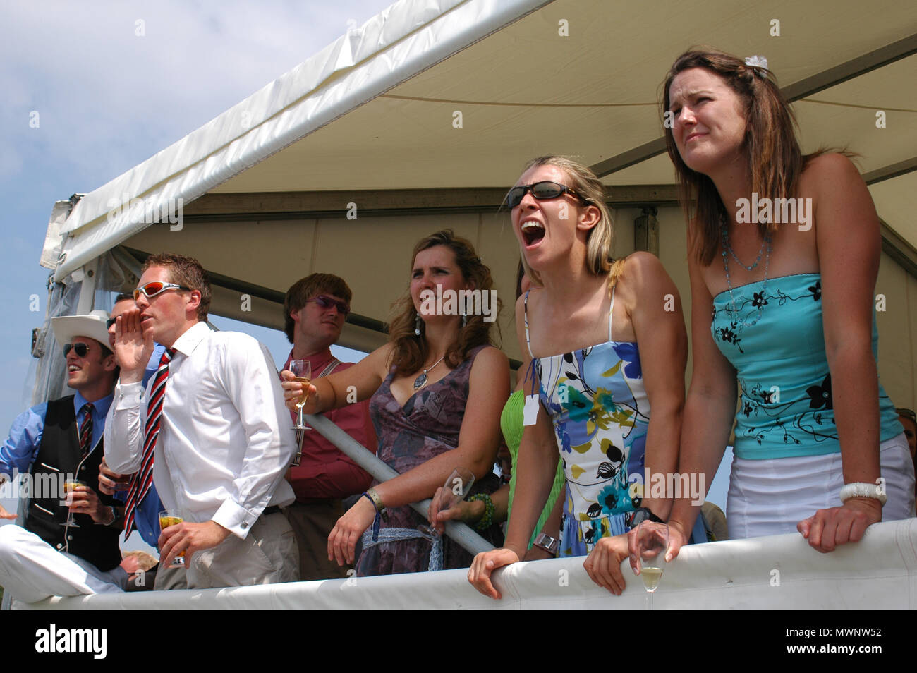 3e77d53a63fd53 Spectators cheering the rowers on, Henley Royal Regatta, Oxfordshire, UK