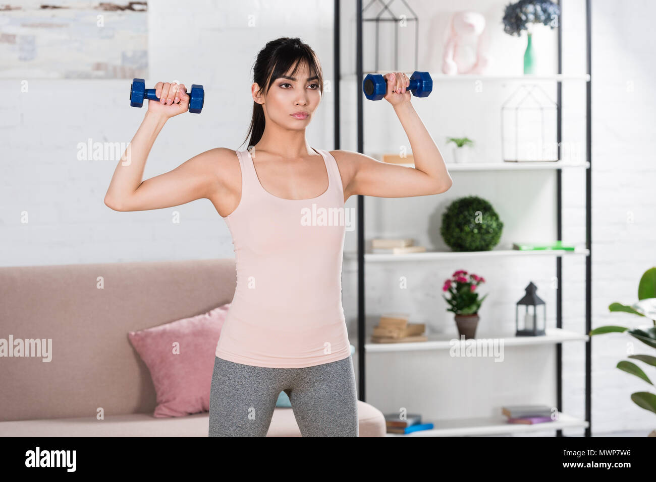 Attractive Girl Doing Workout Dumbbells Stock Photos