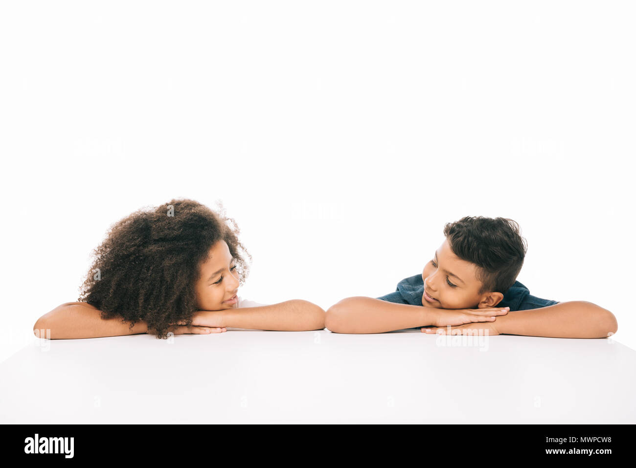 Beautiful African American Brother And Sister Smiling Each Other Isolated On White