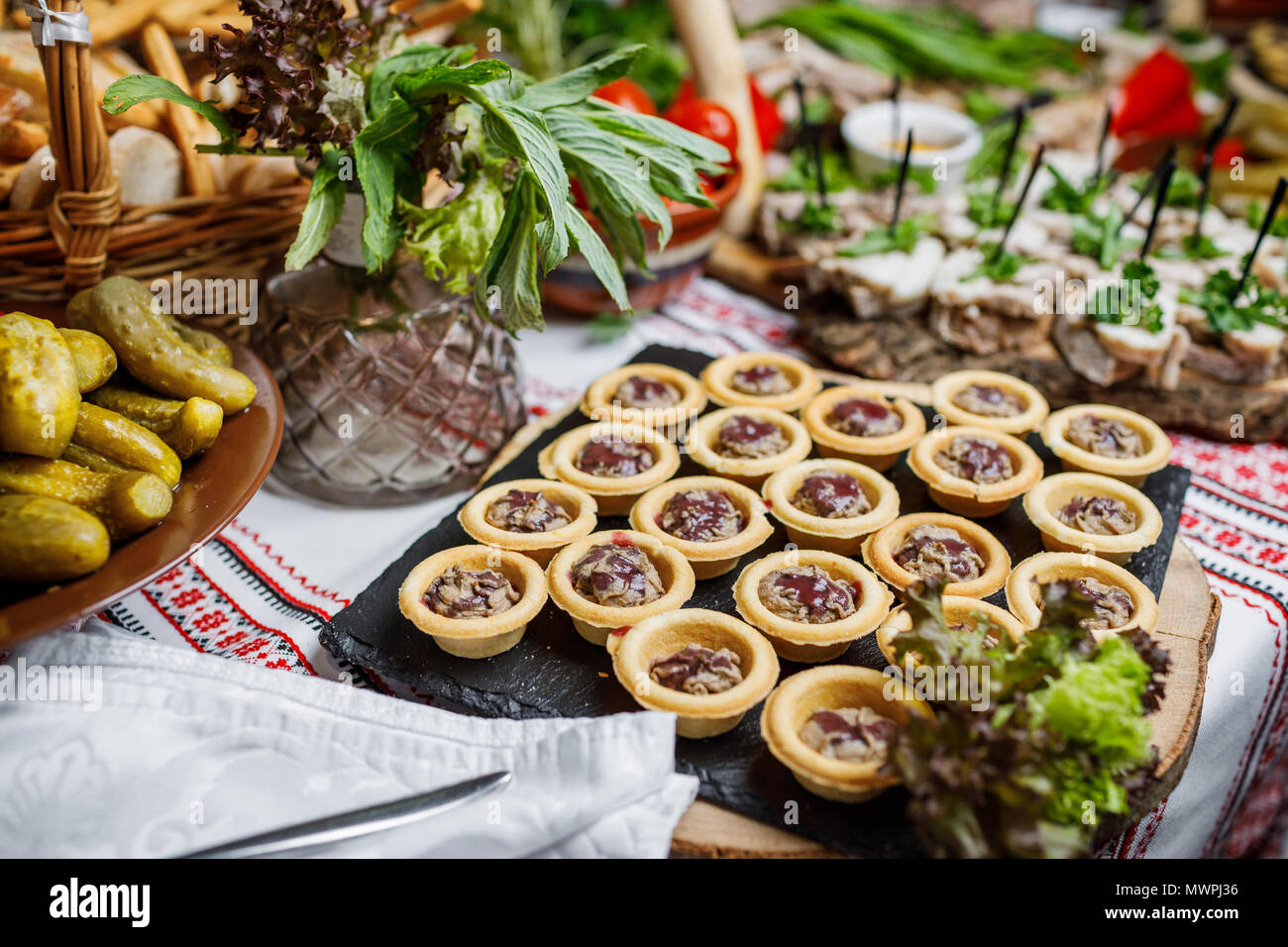 beautifully decorated catering banquet table with different food snacks and appetizers on corporate christmas birthday party event or wedding celebrat