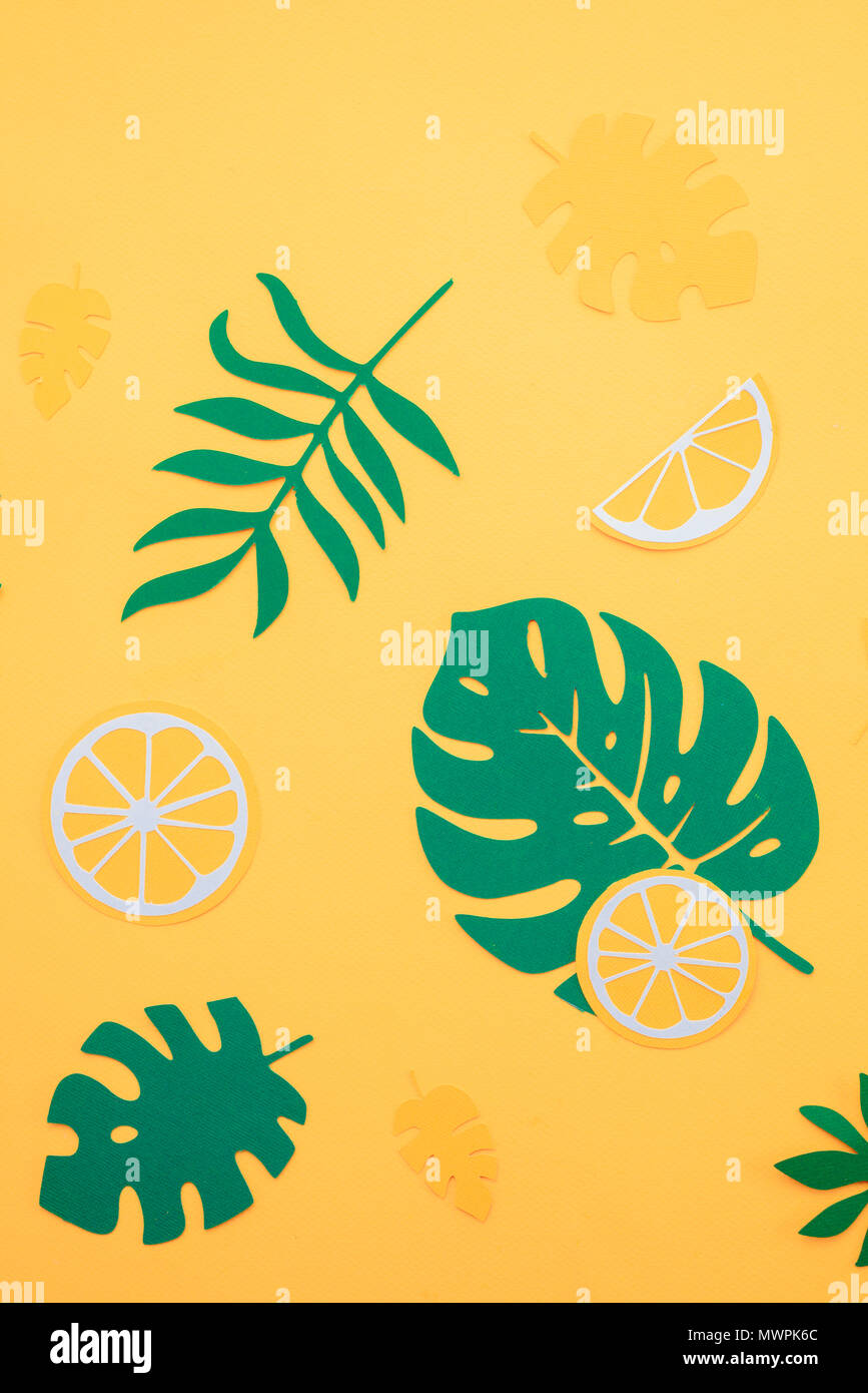 tropical leaves pattern green monstera and fern leaves with orange