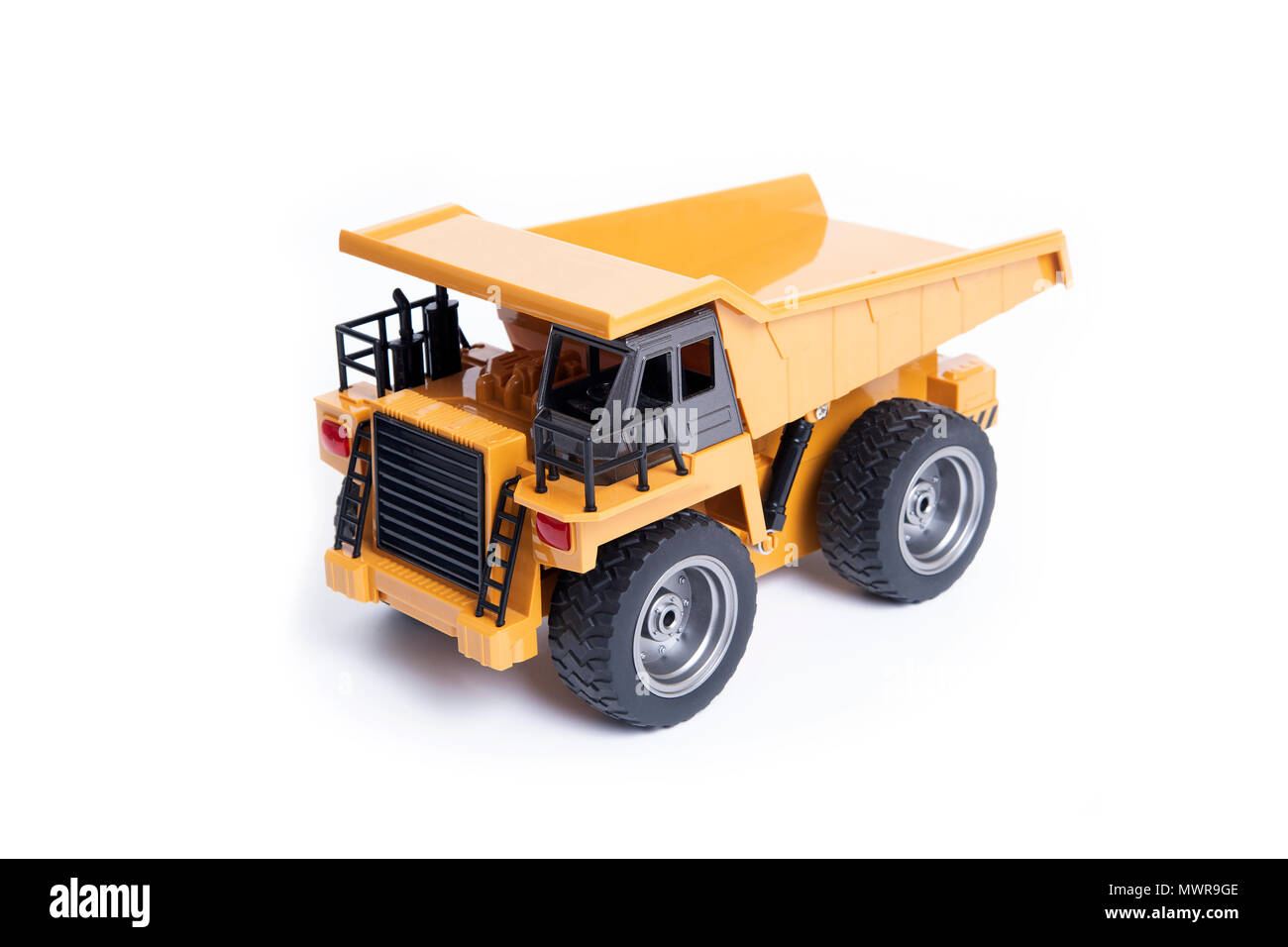 Toy model of heavy truck for mining on white background. - Stock Image