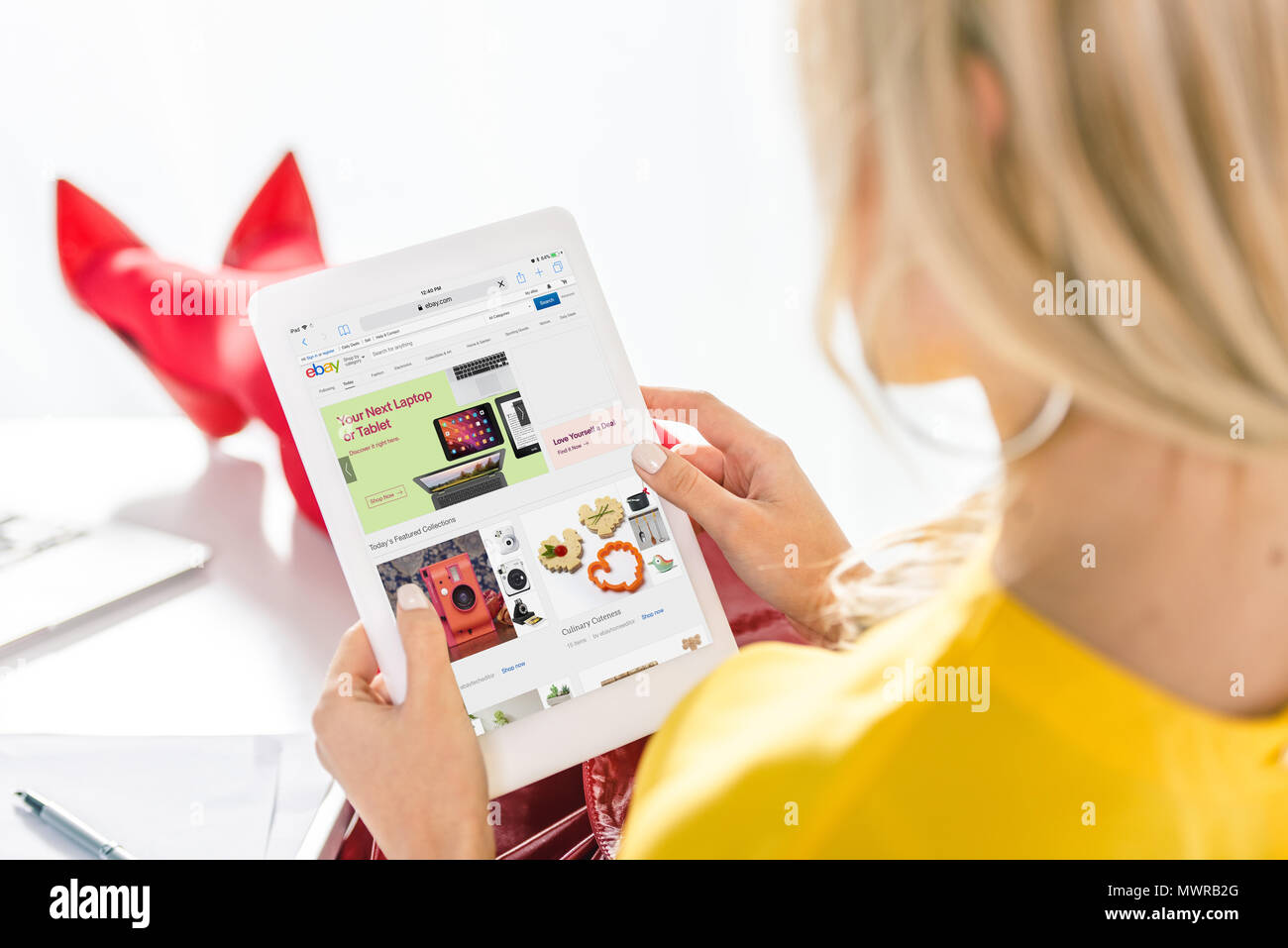 1ed729188 cropped view of woman shopping online with digital tablet with ebay website