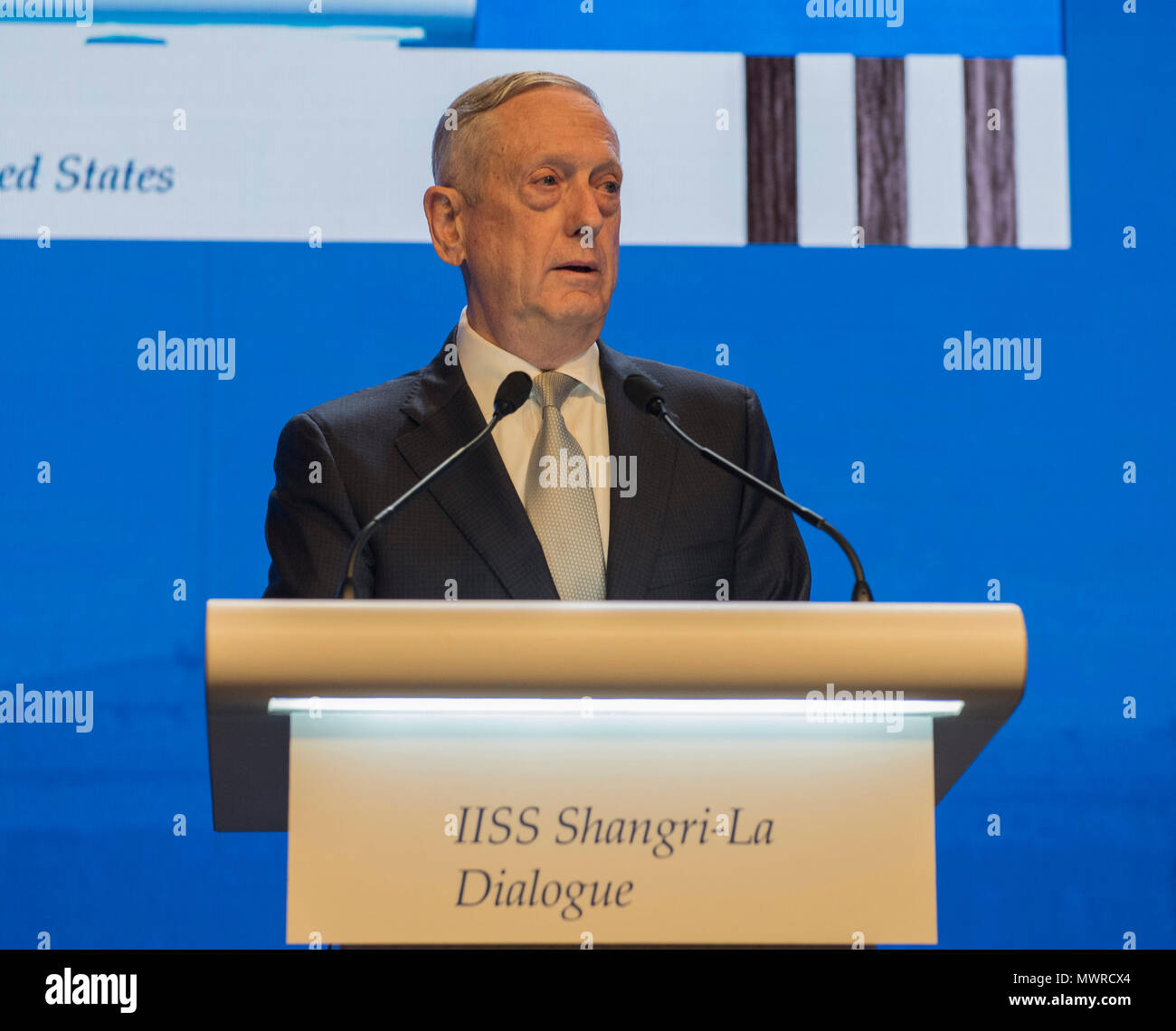 180602-N-OU129-205 SINGAPORE (June 1, 2018) Secretary of Defense Jim Mattis delivers remarks during the first plenary session of the Shangri-La Dialogue 2018 June 2. The Shangri-La Dialogue, held annually by the independent think tank, the International Institute for Strategic Studies (IISS), is an inter-governmental security forum which is attended by defense ministers and delegates from more than 50 nations. (U.S. Navy photo by Mass Communication Specialist 2nd Class Joshua Fulton/Released) - Stock Image