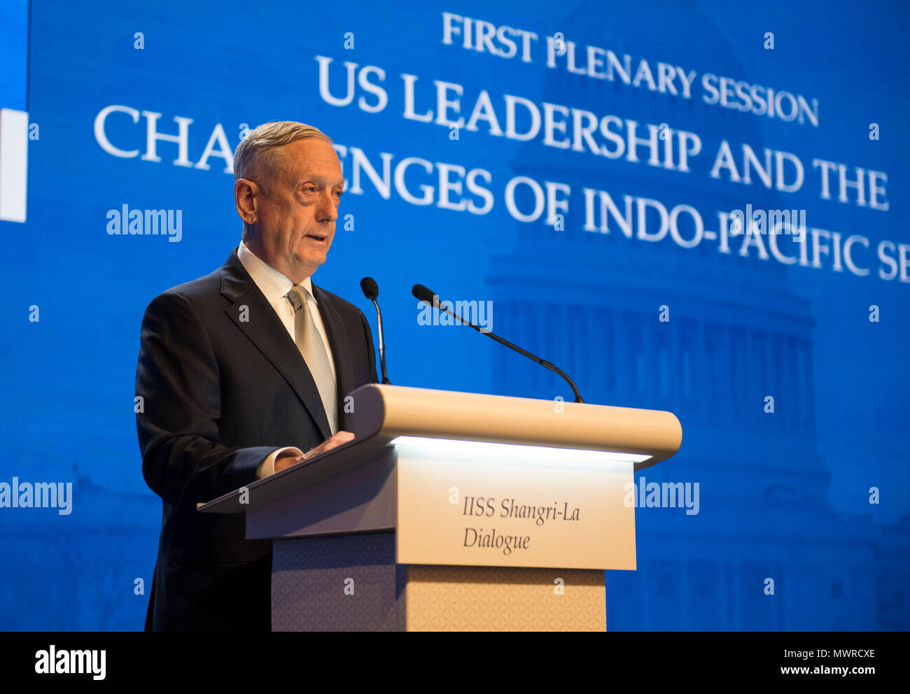 180602-N-OU129-267 SINGAPORE (June 1, 2018) Secretary of Defense Jim Mattis delivers remarks during the first plenary session of the Shangri-La Dialogue 2018 June 2. The Shangri-La Dialogue, held annually by the independent think tank, the International Institute for Strategic Studies (IISS), is an inter-governmental security forum which is attended by defense ministers and delegates from more than 50 nations. (U.S. Navy photo by Mass Communication Specialist 2nd Class Joshua Fulton/Released) - Stock Image