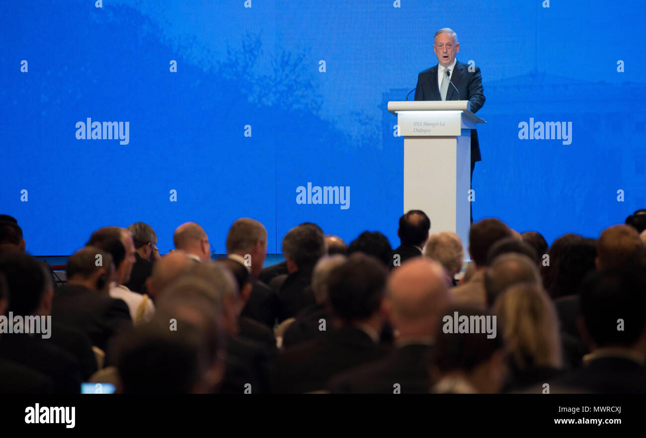 180602-N-OU129-298 SINGAPORE (June 1, 2018) Secretary of Defense Jim Mattis delivers remarks during the first plenary session of the Shangri-La Dialogue 2018 June 2. The Shangri-La Dialogue, held annually by the independent think tank, the International Institute for Strategic Studies (IISS), is an inter-governmental security forum which is attended by defense ministers and delegates from more than 50 nations. (U.S. Navy photo by Mass Communication Specialist 2nd Class Joshua Fulton/Released) - Stock Image