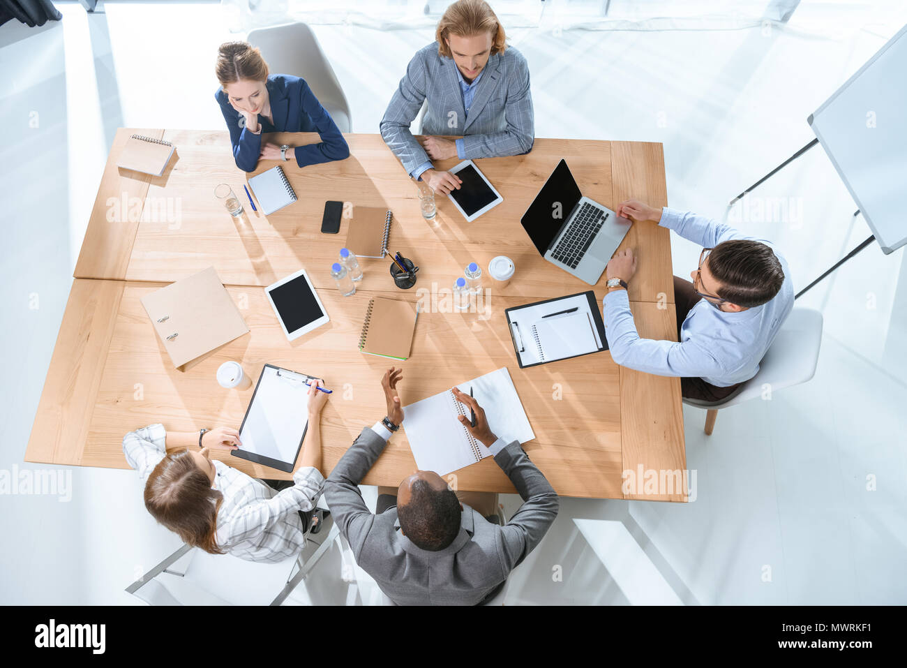 business team working while siting at table at office space - Stock Image