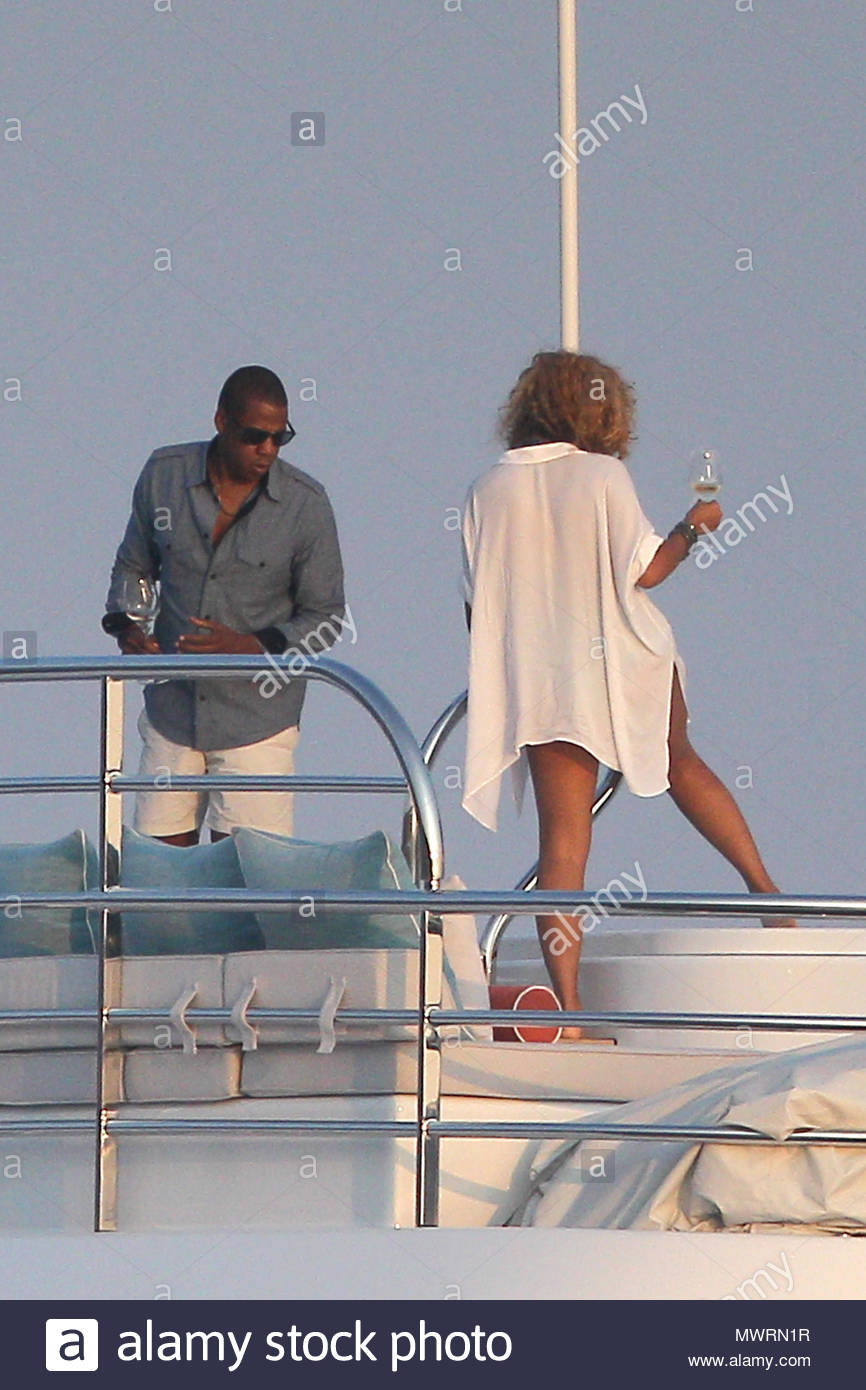 742db034535 Beyonce photographed feeding Blue Ivy on the the top deck of her chartered  superyacht with partner Jay Z whilst on holiday in the South of France.