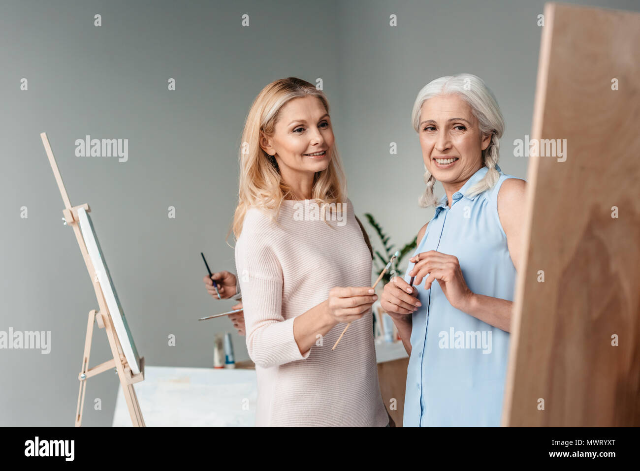 Something is. Women posing for art classes