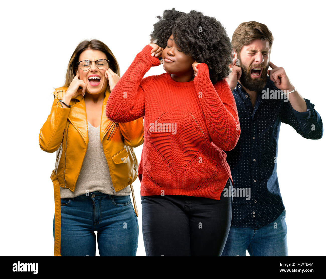Group of three young men and women covering ears ignoring
