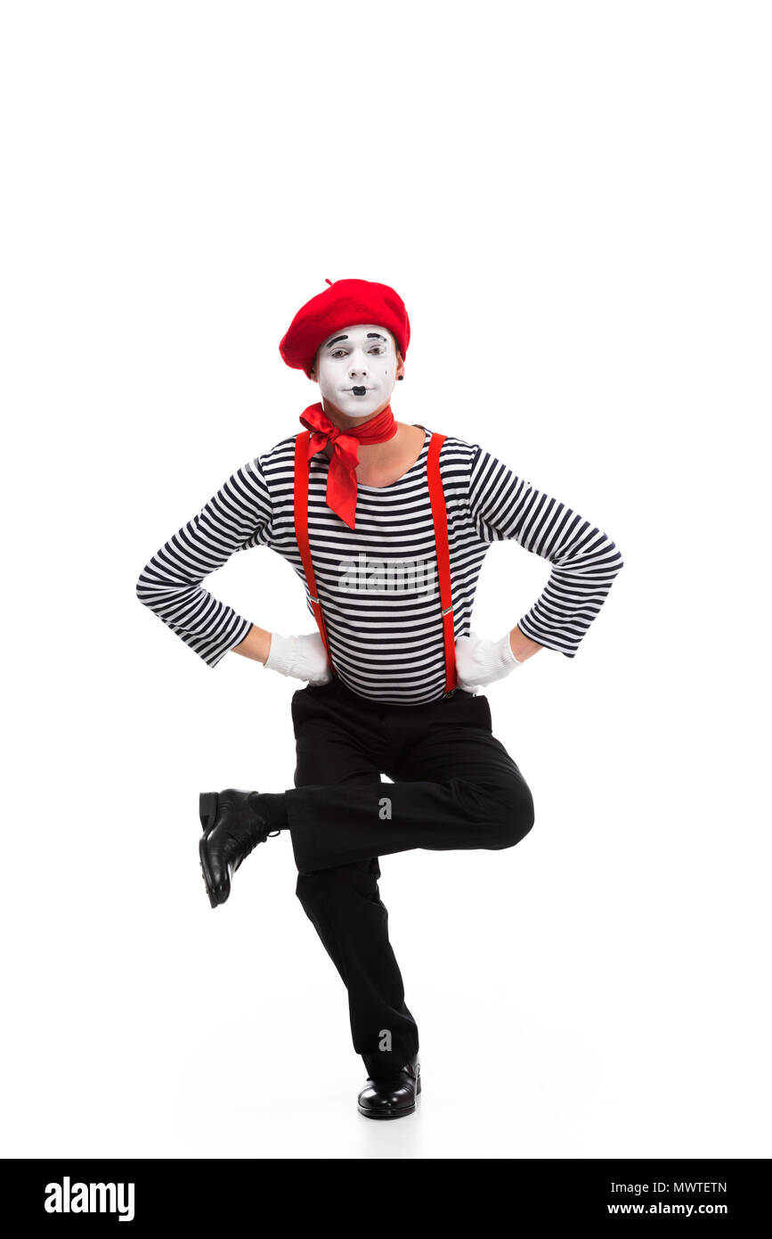 funny mime performing on one leg isolated on white - Stock Image
