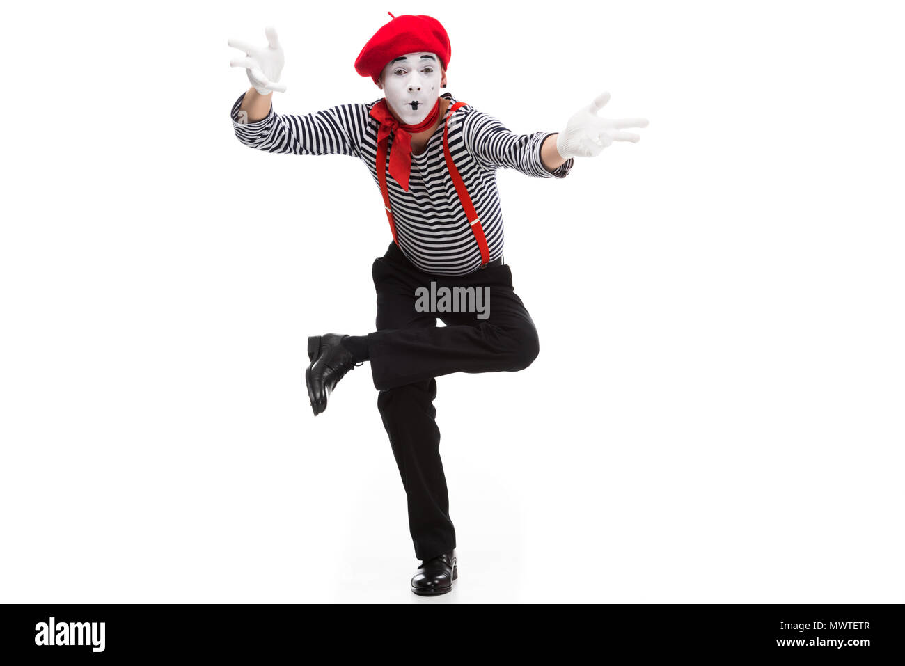 funny mime performing and gesturing isolated on white - Stock Image