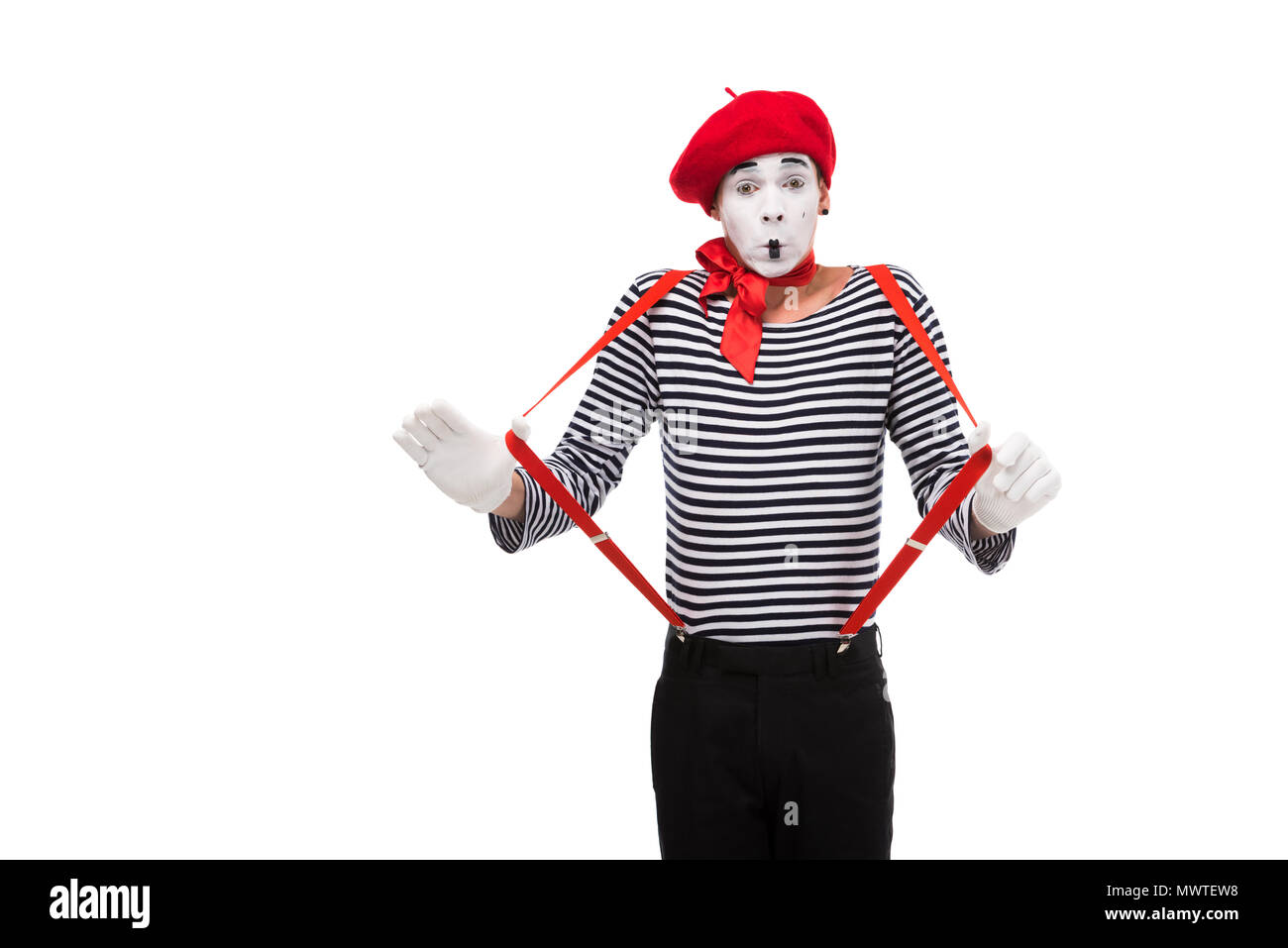 shocked mime with red suspenders isolated on white - Stock Image