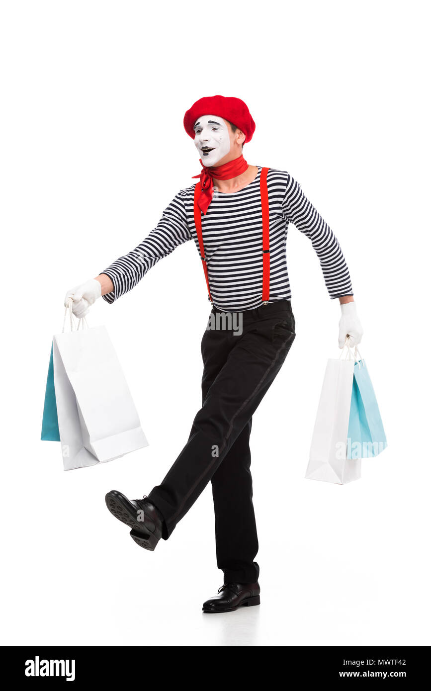 mime walking with shopping bags isolated on white - Stock Image