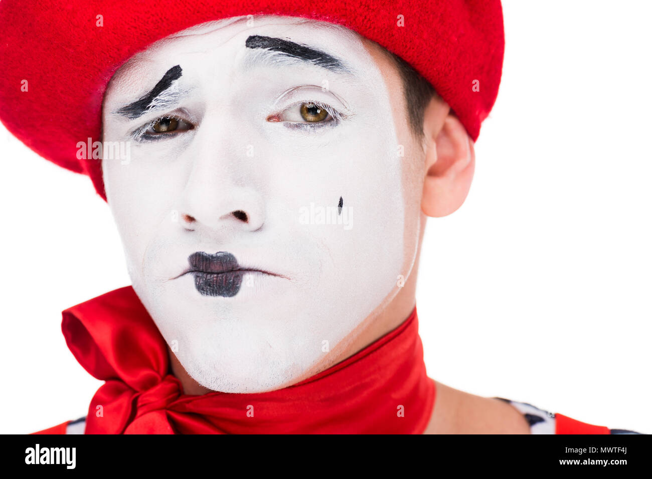 portrait of grimacing mime with makeup isolated on white - Stock Image