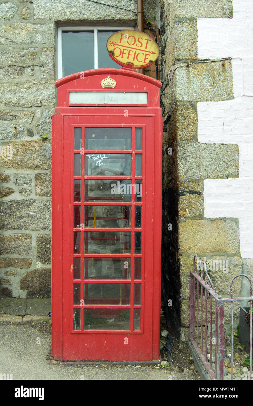 Red Telephone Box and Post Office Sign, Mousehole, Cornwall UK - Stock Image