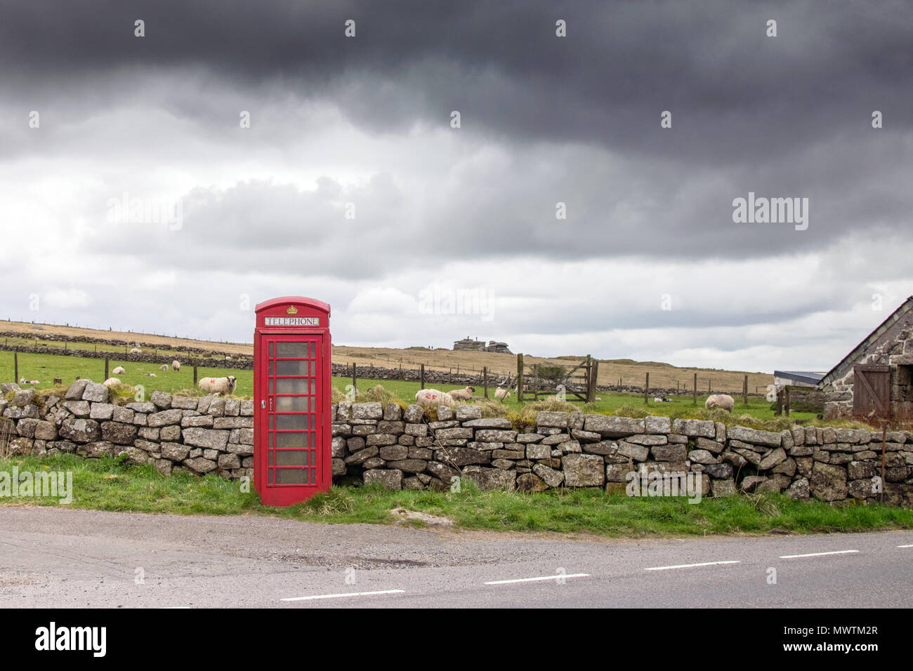 Red Telephone Box near Dartmoor Prison and Vixen Tor, Princetown, Devon UK - Stock Image