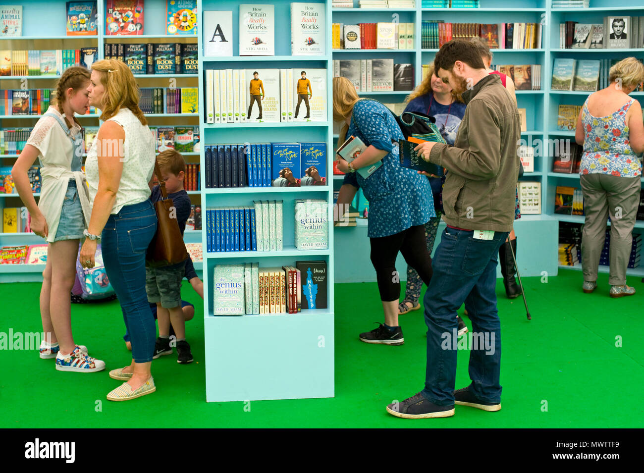 People browsing bookshelves in the bookshop at Hay Festival 2018 Hay-on-Wye Powys Wales UK - Stock Image