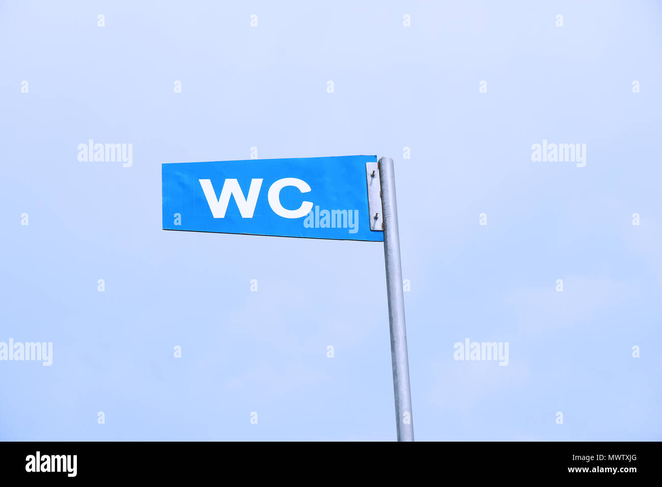 WC sign for public toilet or restroom against sky - Stock Image