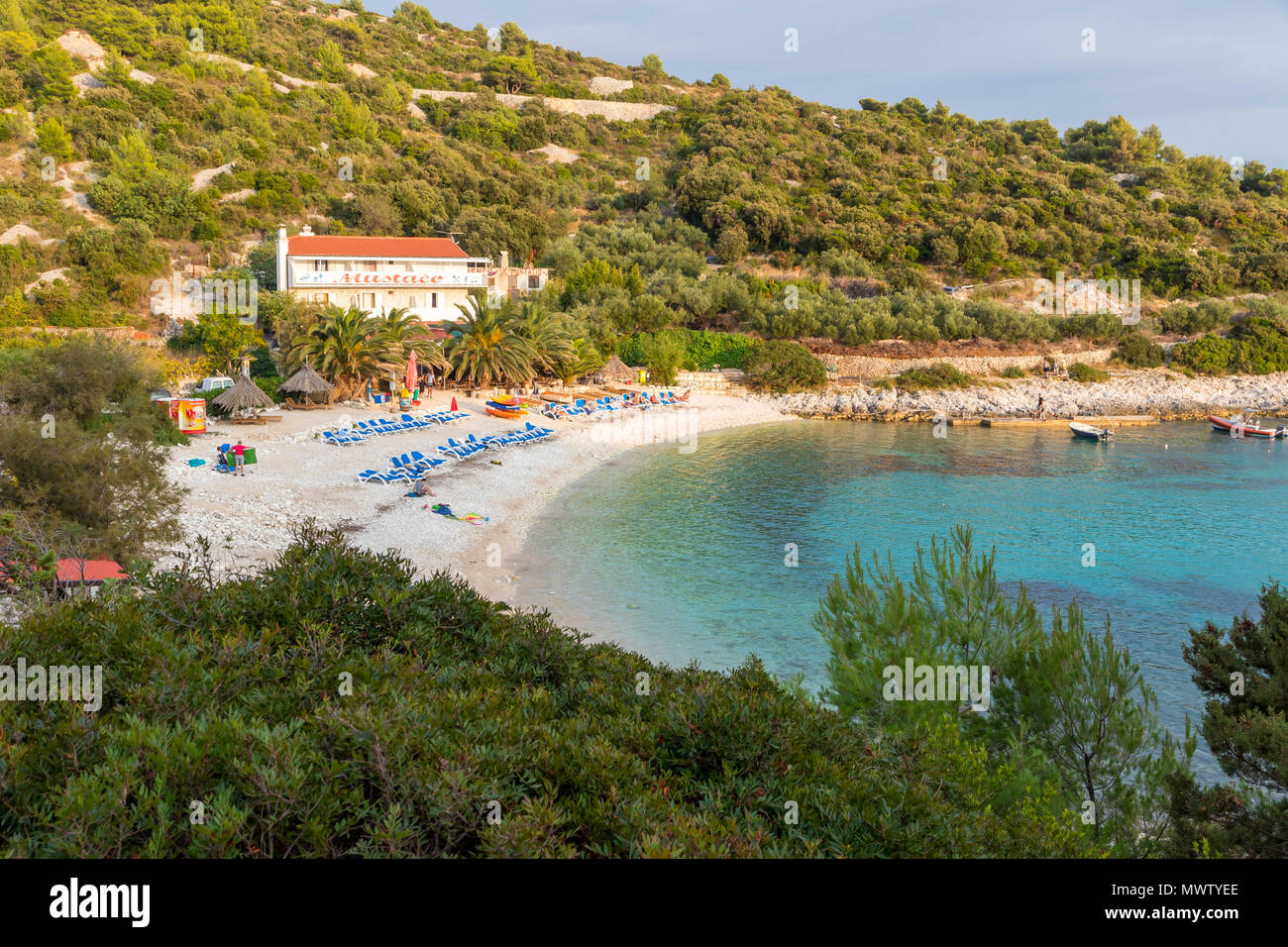 Elevated view over Pokonji Dol Beach near Hvar Town at sunset, Hvar, Croatia, Europe - Stock Image