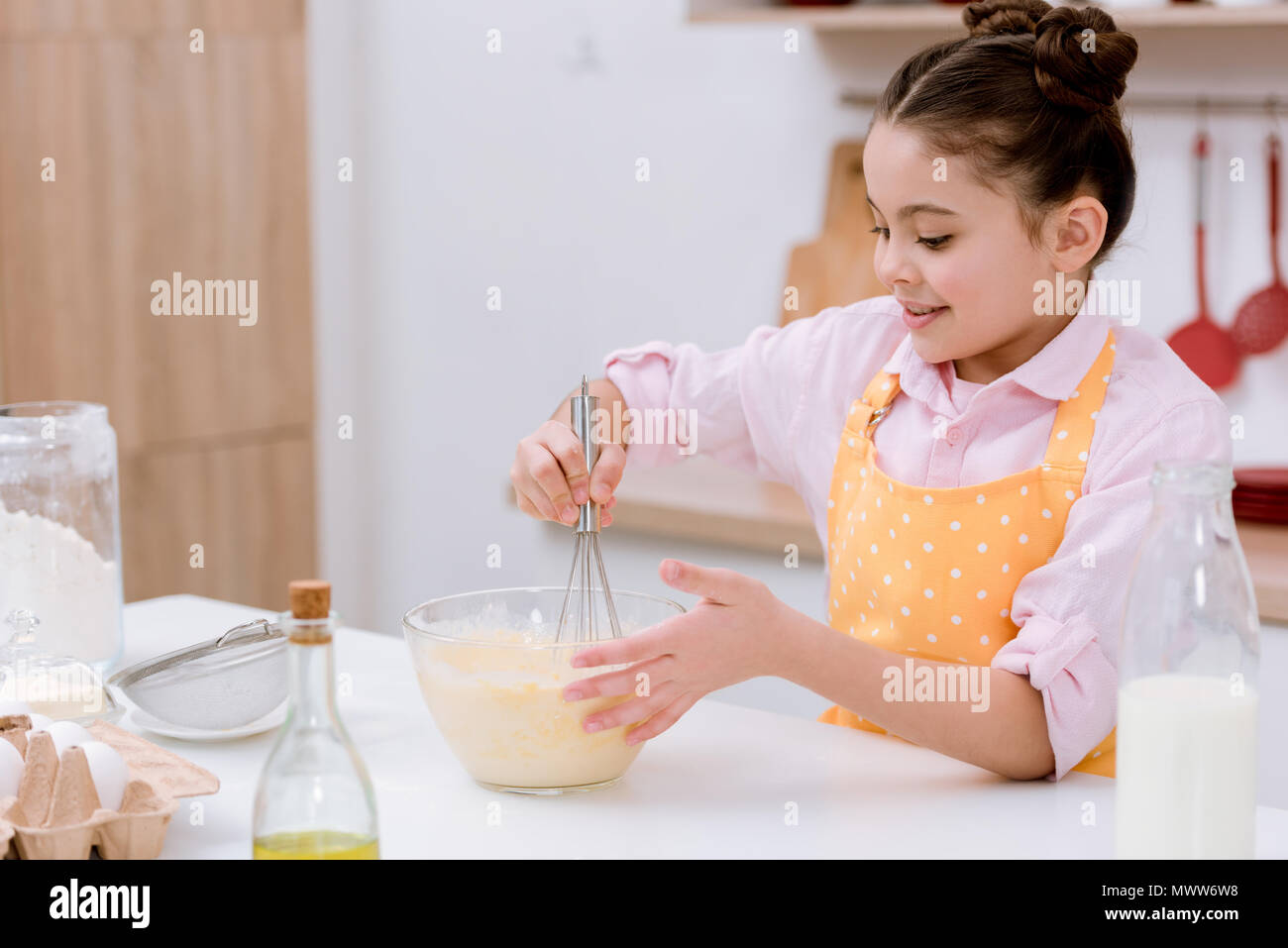 adorable little child mixing dough for pastry - Stock Image