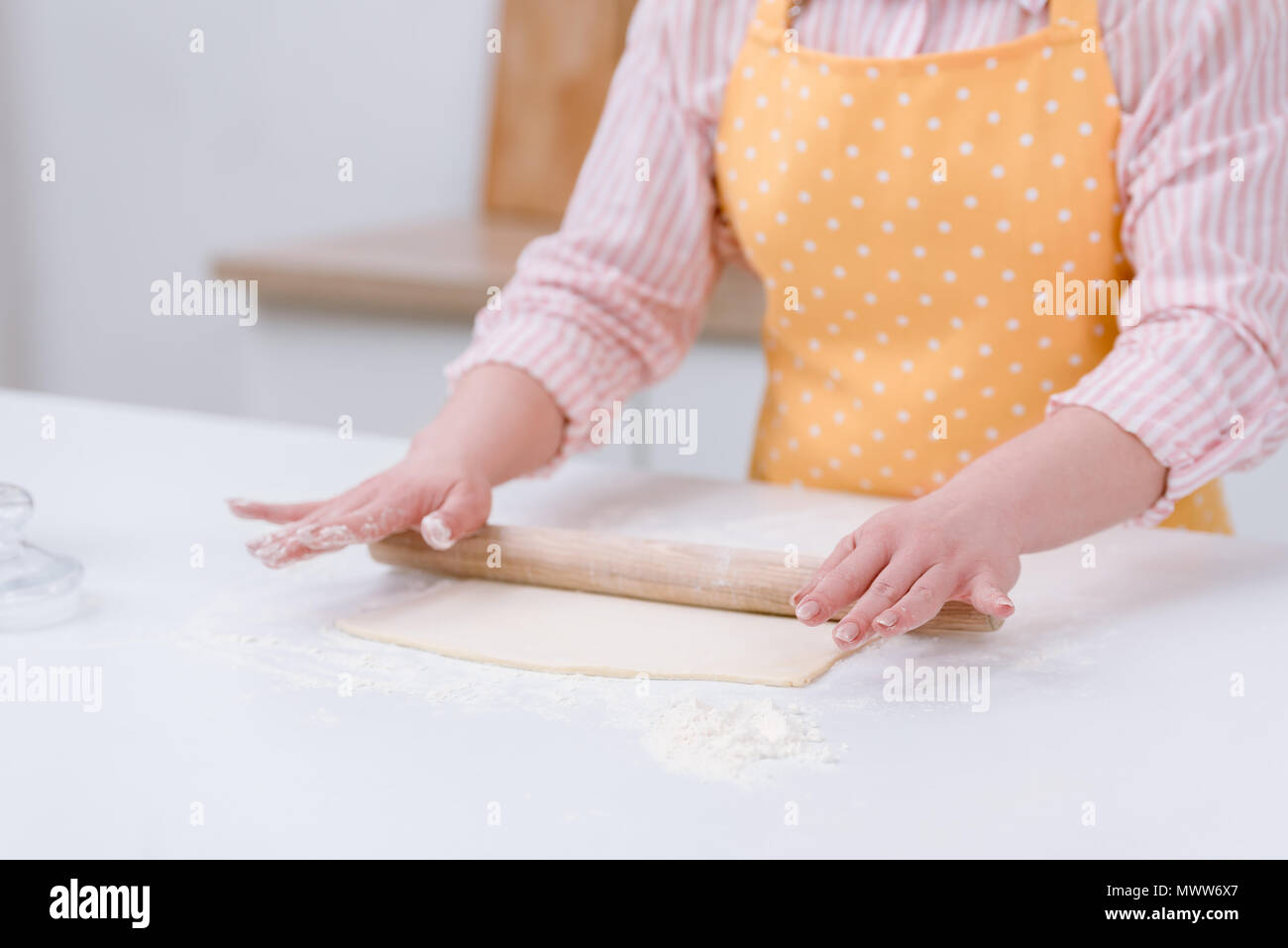 cropped shot of woman rolling dough for pastry at kitchen - Stock Image