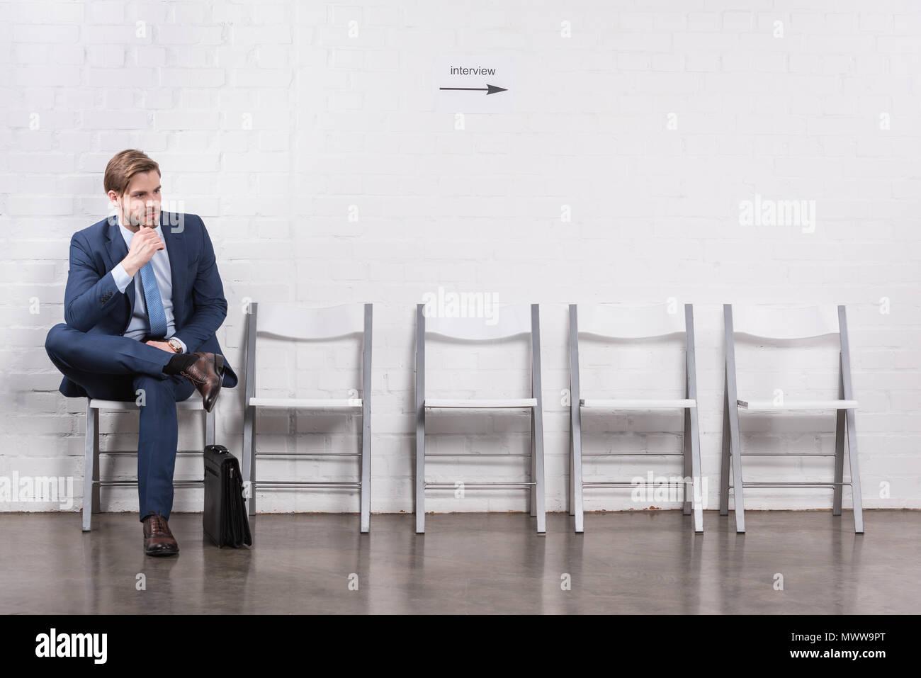 pensive caucasian businessman waiting for job interview - Stock Image