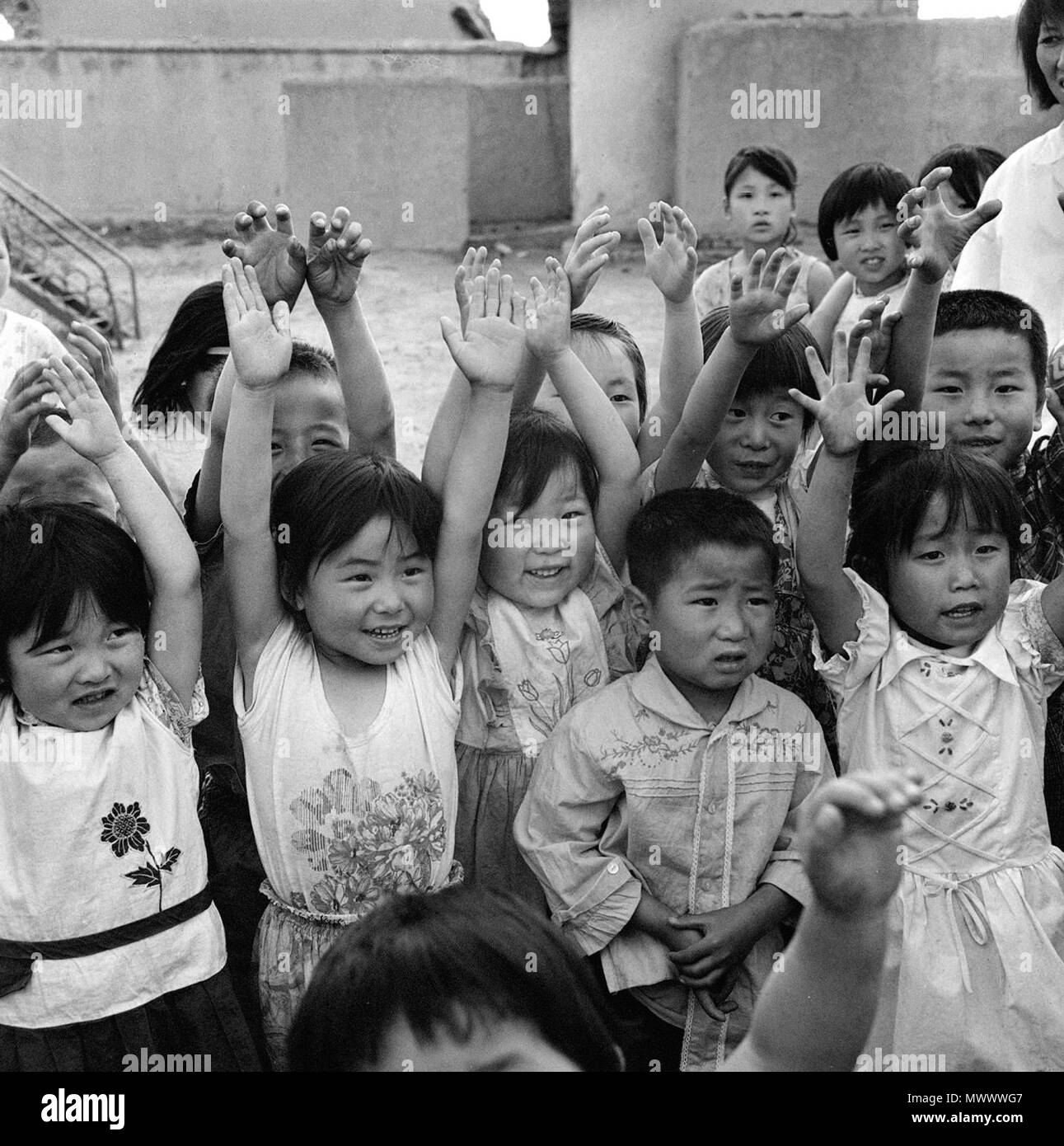 Beijing, China. 2nd June, 2018. File photo taken in August of 1981 shows children's reaction when being checked their hands after cleaning at a kindergarten in north China's Inner Mongolia Autonomous Region. This set of 41 old photos, taken from 1978 to 2018 by year, pictorially record childhood moments of Chinese kids in the past four decades. Credit: Tang Maolin/Xinhua/Alamy Live News - Stock Image