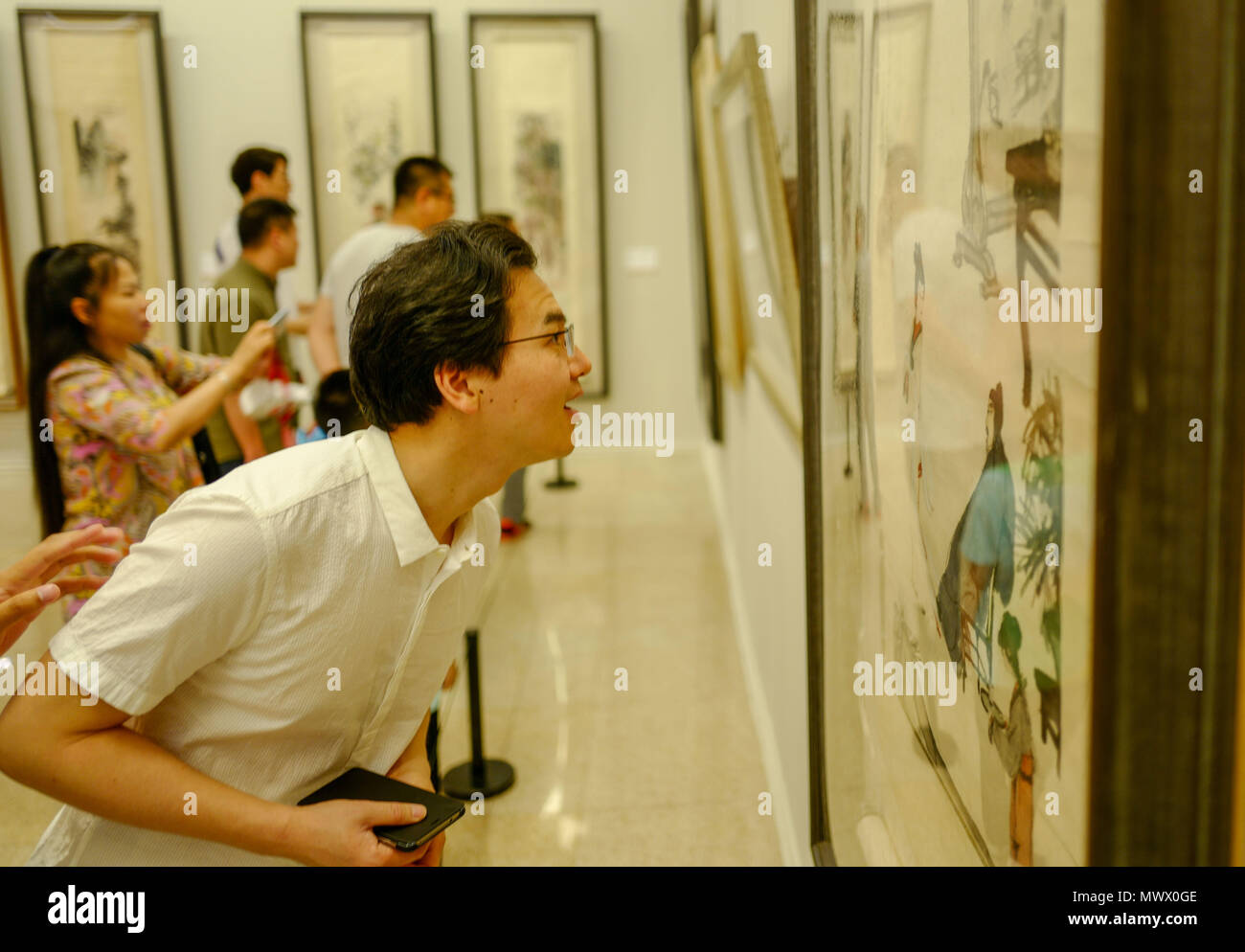 Beijing, China. 2nd June, 2018. Visitors view exhibits during the 'Talent Shining Like Bright Stars -- Academic Invitation Exhibition of Jiangxi Art Works in Beijing' in National Art Museum of China in Beijing, capital of China, June 2, 2018. Credit: Liu Chan/Xinhua/Alamy Live News - Stock Image