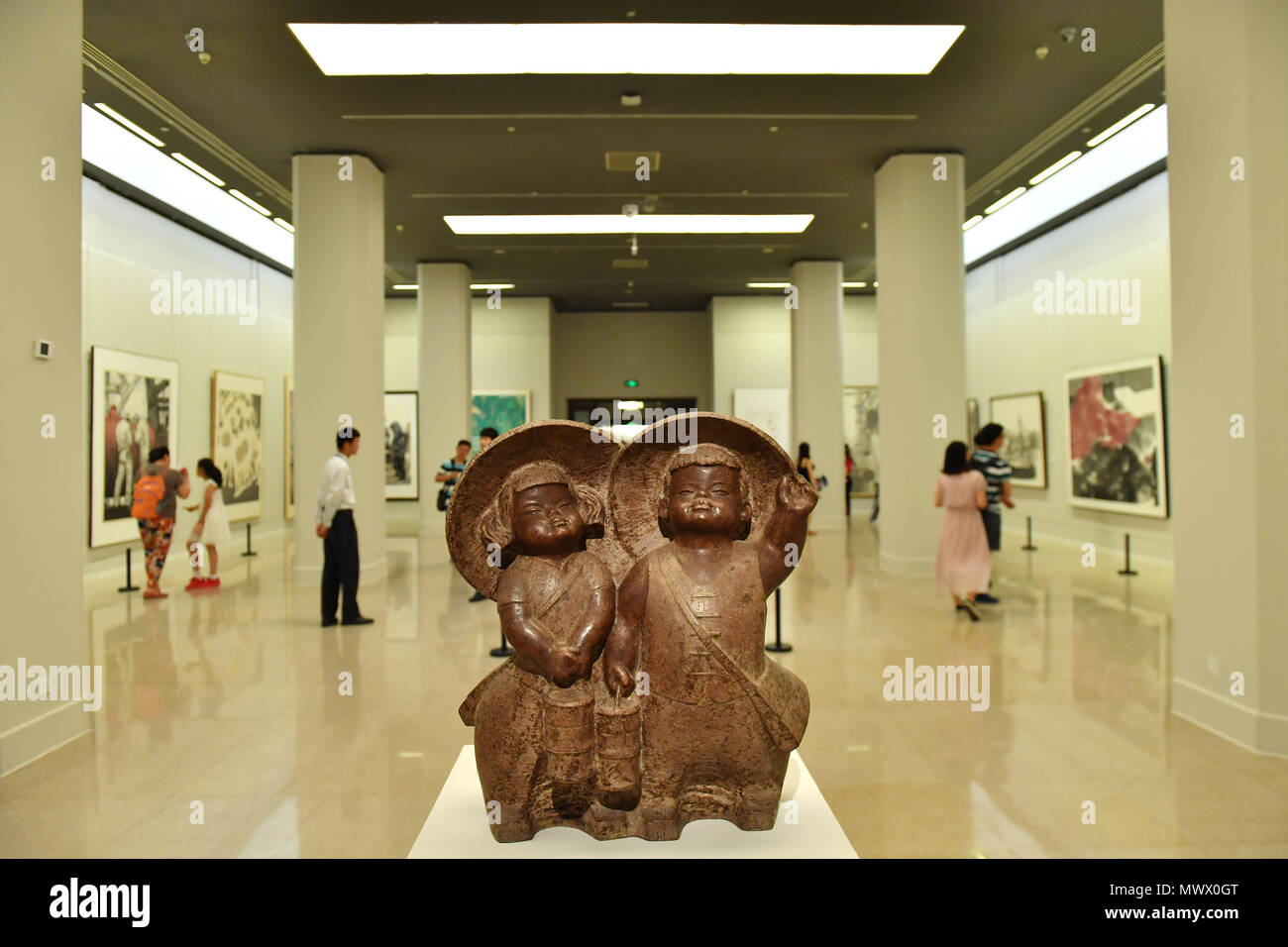 Beijing, China. 2nd June, 2018. Visitors view exhibits during the 'Talent Shining Like Bright Stars -- Academic Invitation Exhibition of Jiangxi Art Works in Beijing' in National Art Museum of China in Beijing, capital of China, June 2, 2018. Credit: Sun Ruibo/Xinhua/Alamy Live News - Stock Image
