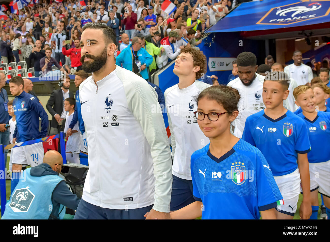 Nice, France. 1st June 2018. Soccer Football - International Friendly - France vs Italy - Allianz Riviera, Nice, France - June 1, 2018 France's Adil Rami and a mascot before the match Credit: BTWImages Sport/Alamy Live News - Stock Image