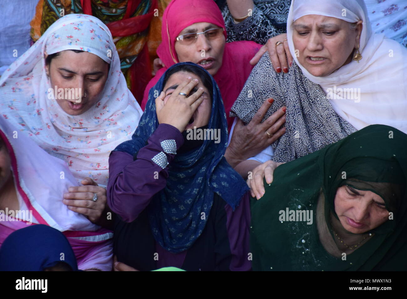 Kashmir, India  2nd June 2018  Kashmiri women grieve near the body