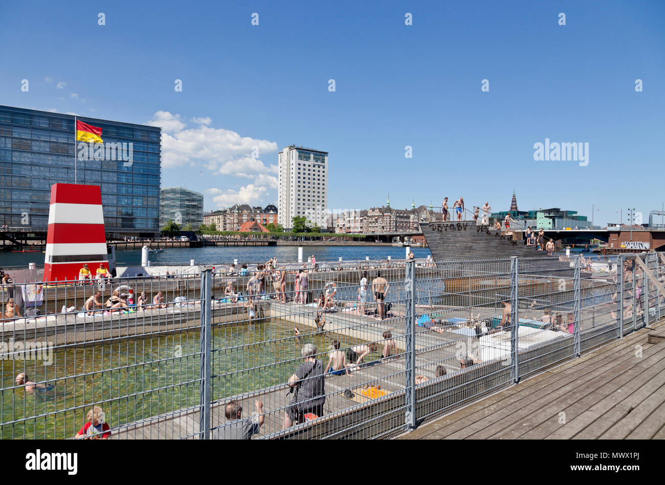 Copenhagen, Denmark. 2nd June, 2018. On the second day of the harbour bath season that began yesterday thousands of Copenhageners, tourists and visitors enjoy another warm and sunny summer day of the long-lasting and early heat wave that made May the sunniest and warmest on record in Denmark, here in the Islands Brygge Harbour Bath in the inner harbour. In Denmark a summer day is any day on which temperatures top 25 degrees Celsius - until now there have been 19 of these - actually, on many days temperatures have been close to 30 degrees. Credit: Niels Quist / Alamy Live News.Stock Photo