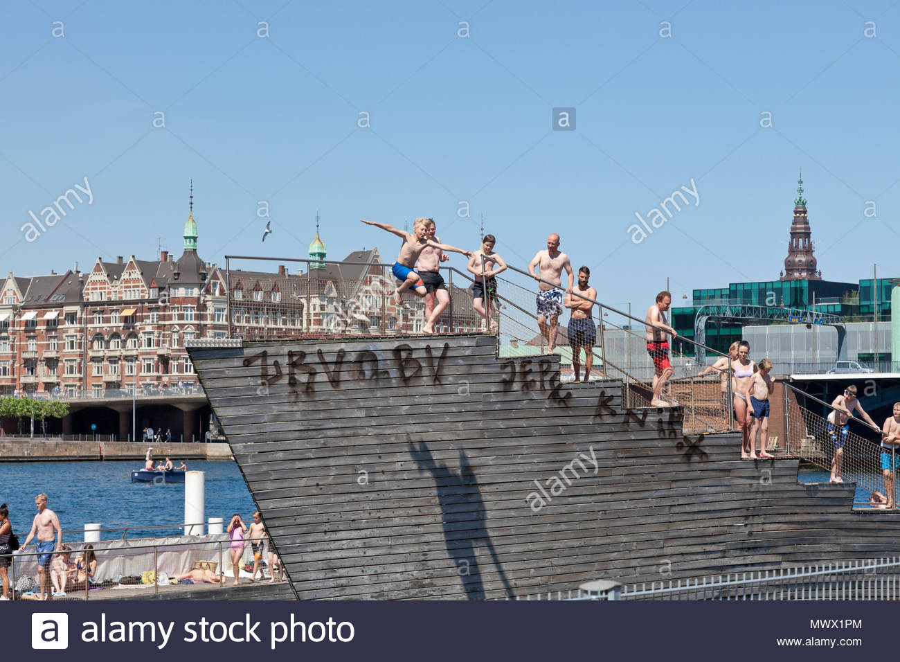 Copenhagen, Denmark. 2nd June, 2018. On the second day of the harbour bath season that began yesterday thousands of Copenhageners, tourists and visitors enjoy another warm and sunny summer day of the long-lasting and early heat wave that made May the sunniest and warmest on record in Denmark, here in the Islands Brygge Harbour Bath in the inner harbour. In Denmark a summer day is any day on which temperatures top 25 degrees Celsius - until now there have been 19 of these - actually, on many days temperatures have been close to 30 degrees. Credit: Niels Quist / Alamy Live News. Stock Photo