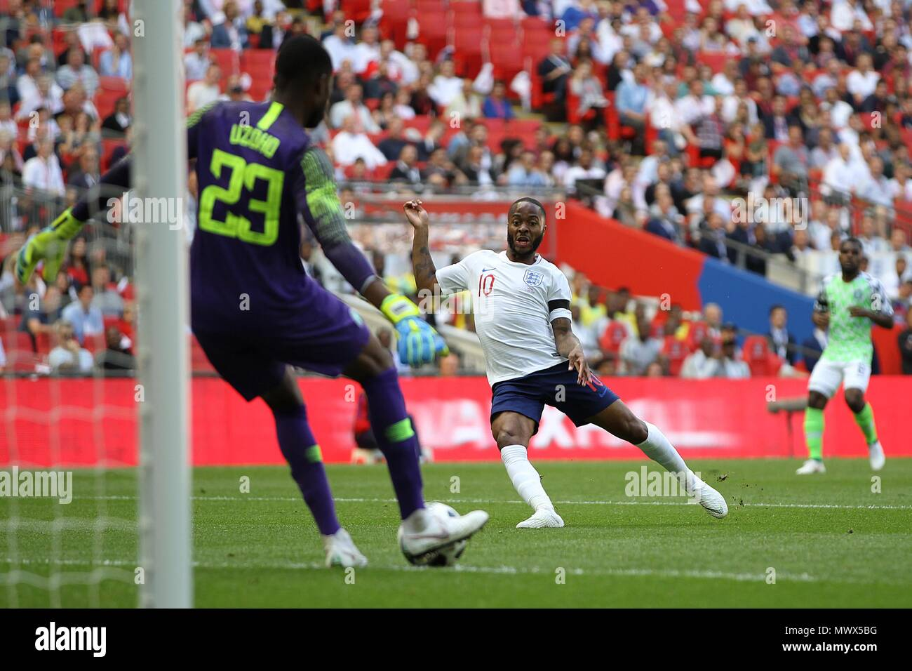London, UK. 2nd June 2018. London, UK. 2nd June 2018.London, UK. 2nd June 2018. Francis Uzoho of Nigeria clears under pressure from Raheem Sterling of England during the International Friendly match between England and Nigeria at Wembley Stadium on June 2nd 2018 in London, England. (Photo by Matt Bradshaw/phcimages.com) Credit: PHC Images/Alamy Live News Stock Photo
