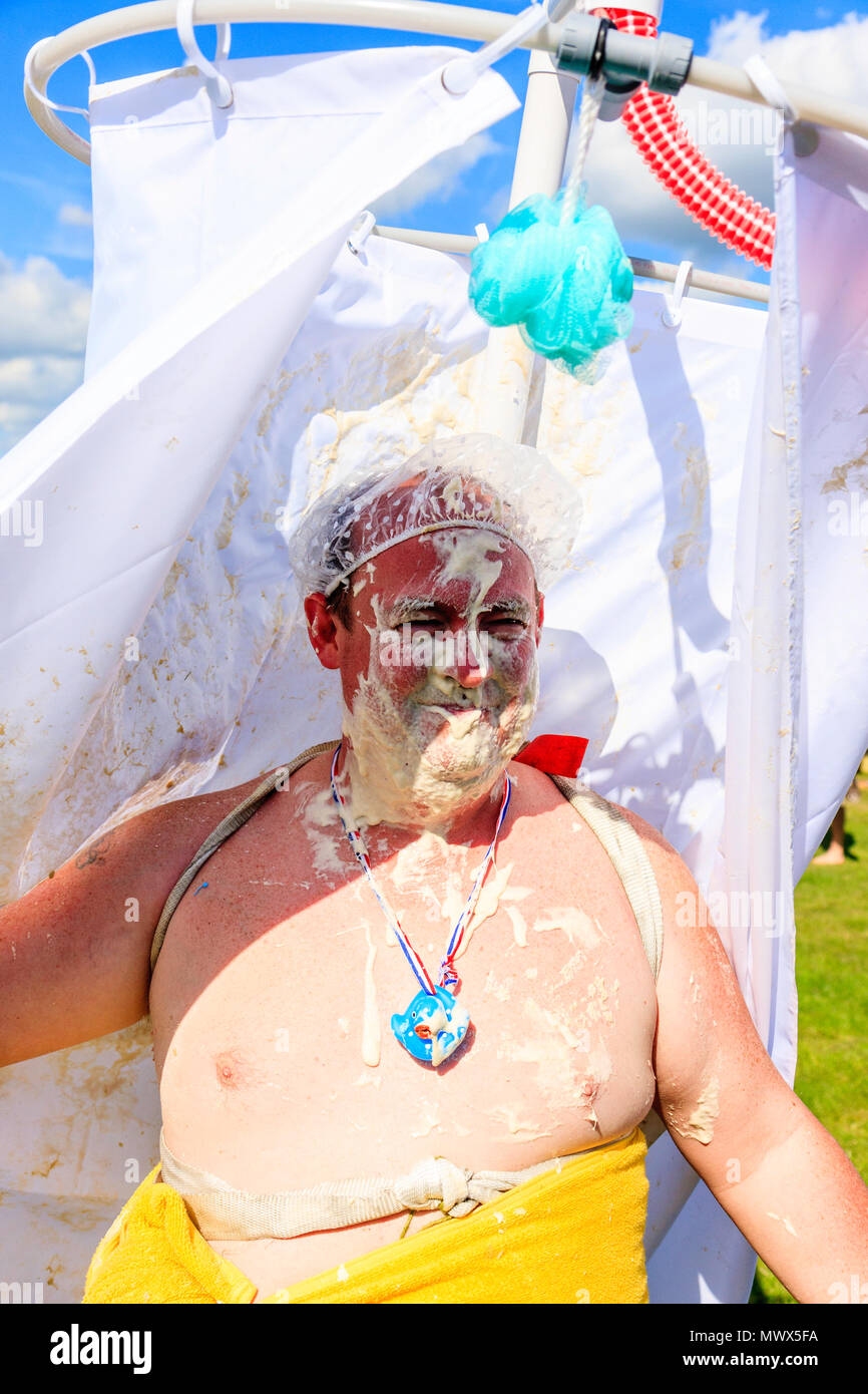 World Custard Pie Championships Large Man Member Of The Swoops Team With Towel Wrapped Around Tummy And Shower Hat Surround Curtain On