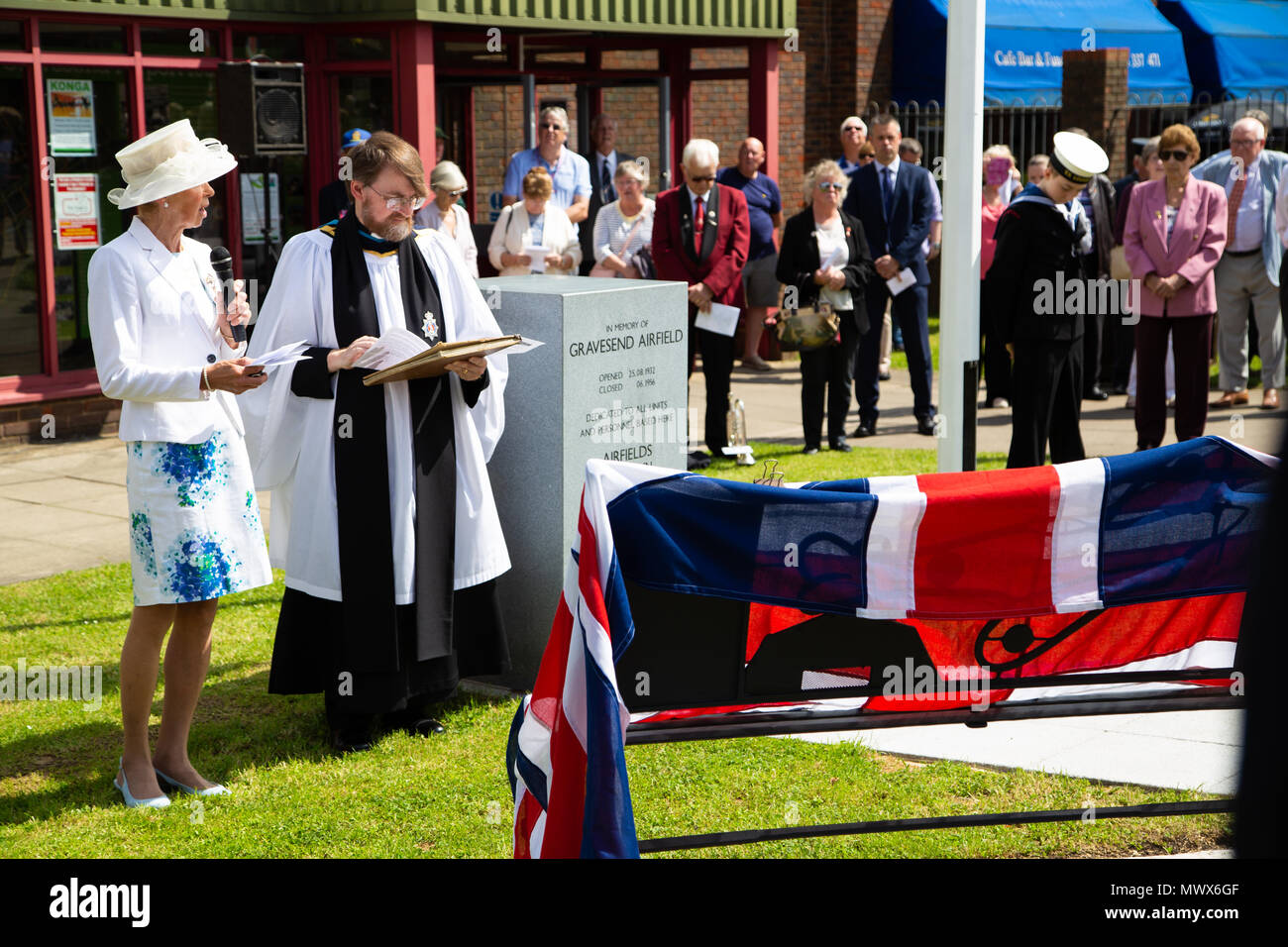 Gravesend Airport, Kent, UK. 2nd Jun, 2018. Mrs Dymond ,Deputy Lieutenant of Kent and the Rev'd Nigel Bourne Dean of Gravesend address the audience attending the memorial service at the site fo the old gravesend airport. Credit A Beck/Alamy live Credit: Andrew Beck/Alamy Live News - Stock Image
