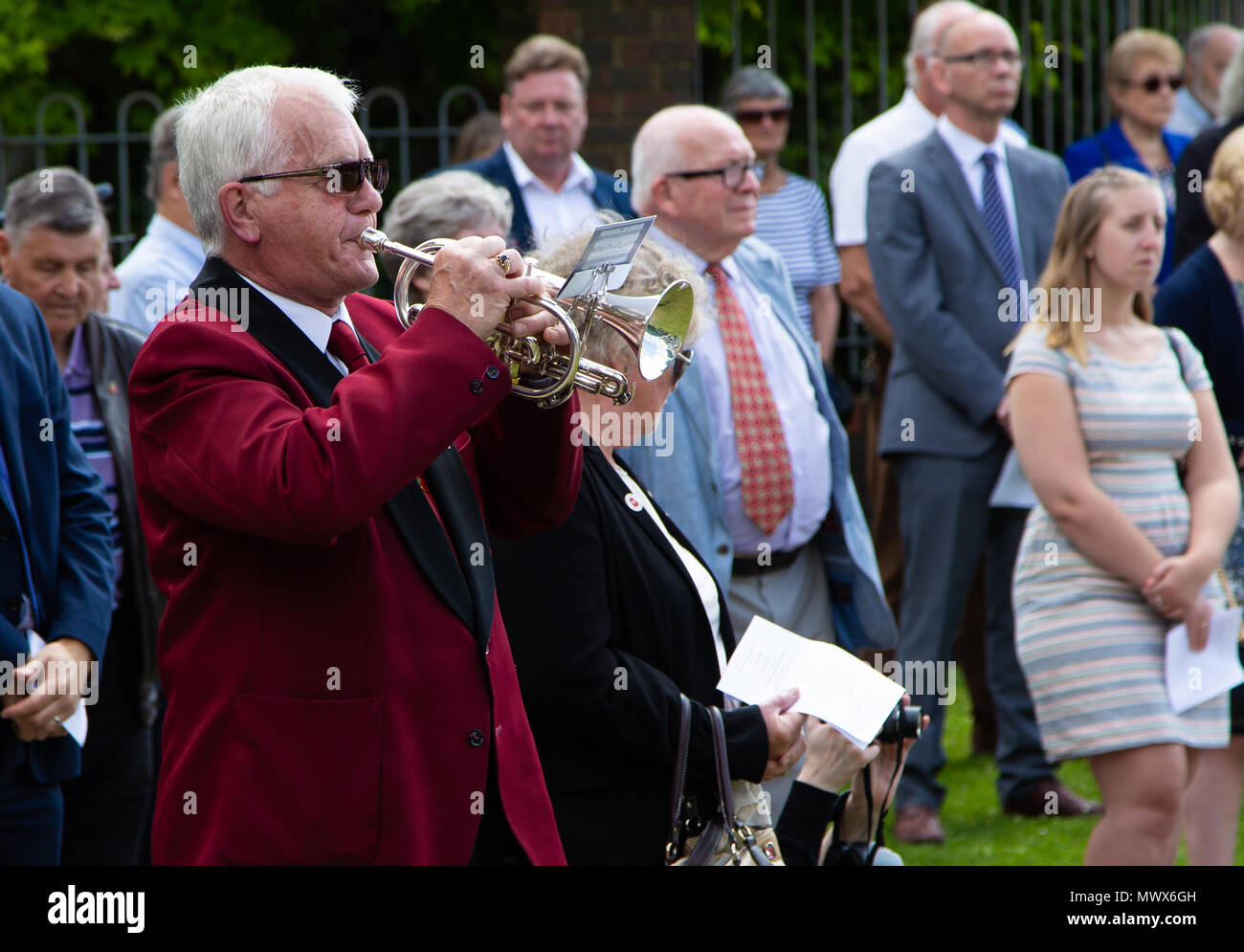 Gravesend Airport, Kent, UK. 2nd Jun, 2018. The last post is played at the memorial at the former Gravesend Airport where new benches were unveiled. Credit A Beck/Alamy Live Credit: Andrew Beck/Alamy Live News - Stock Image
