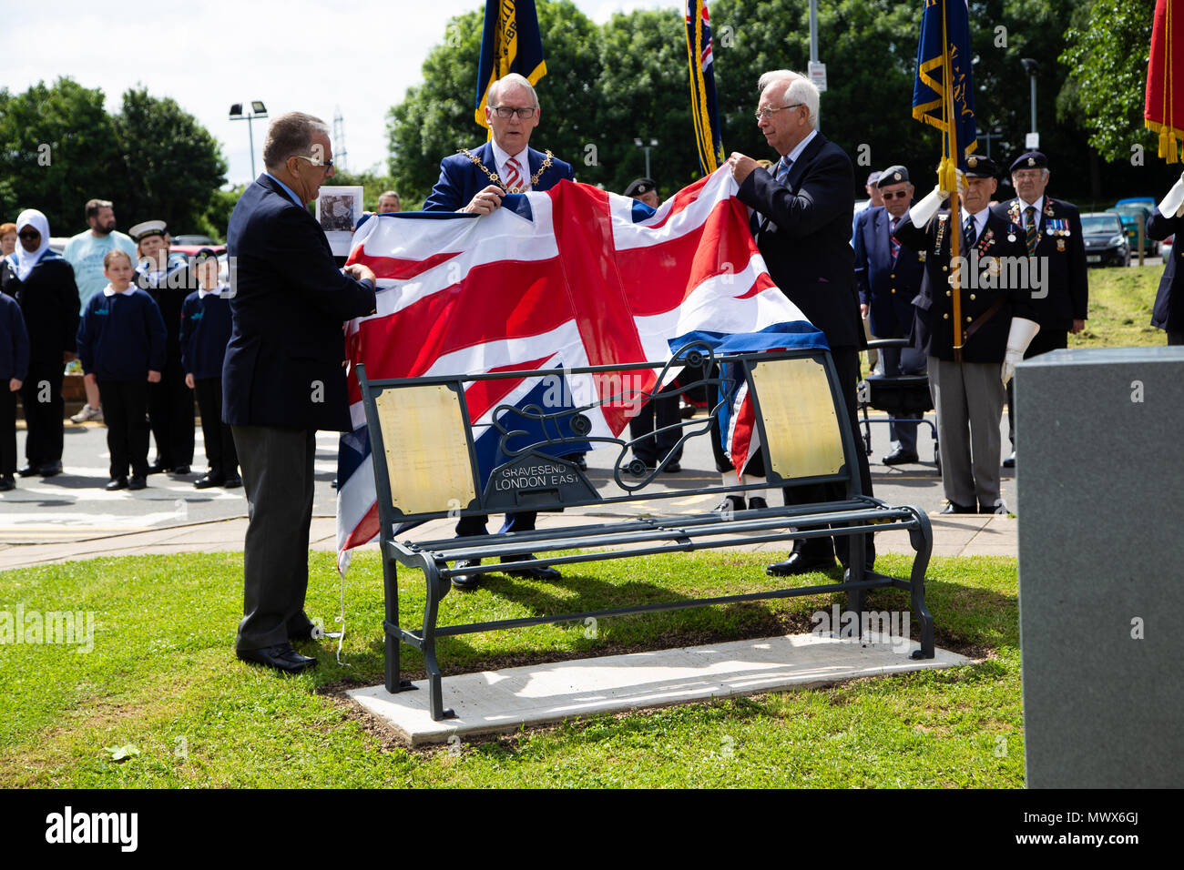 Gravesend Airport, Kent, UK. 2nd Jun, 2018. The Mayor of Gravesham Cllr David Hurley helps unveil the new benches on the site of the old Gravesend airport which played a vital role in the second world war. Credit A Beck/Alamy Live Credit: Andrew Beck/Alamy Live News - Stock Image