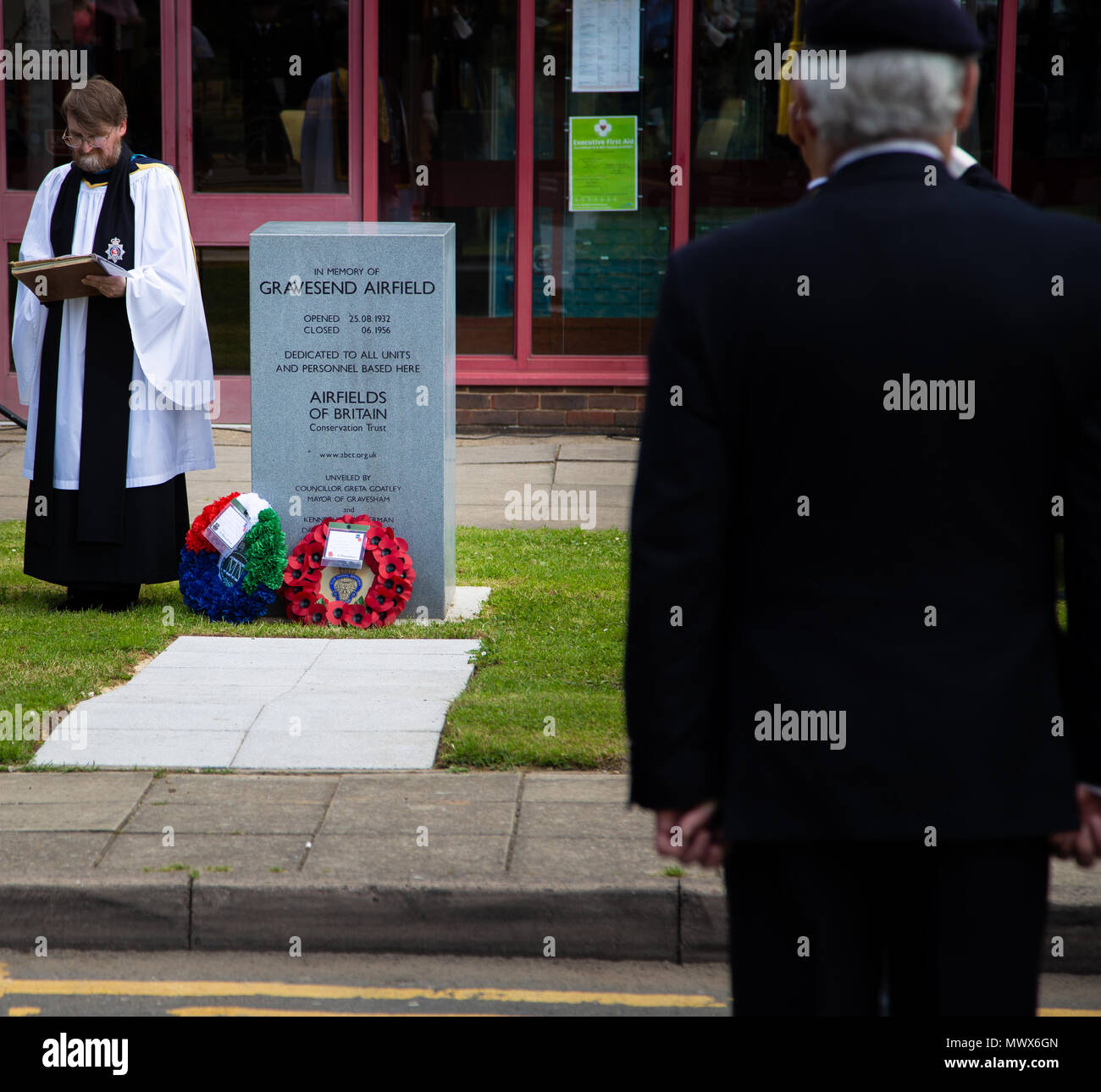 Gravesend Airport, Kent, UK. 2nd Jun, 2018. Veterans stand while a service is given by The Rev'd Nigel Bourne, Dean of Gravesend at the service for lost airmen on the site of the old Gravesend Airport.  Credit A Beck/Alamy Live Credit: Andrew Beck/Alamy Live News - Stock Image