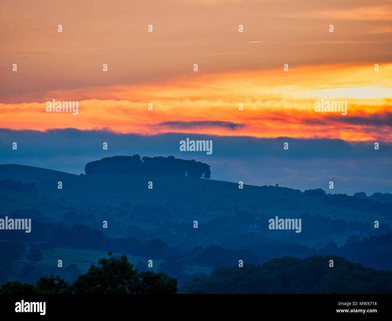 Hazleton Clump Cairn, Ashbourne. 2nd Jun, 2018. UK Weather: spectacular sunset over the ancient woods Hazleton Clump Cairn near Thorpe taken from Ashbourne Derbyshire, Peak District National Park Credit: Doug Blane/Alamy Live NewsStock Photo